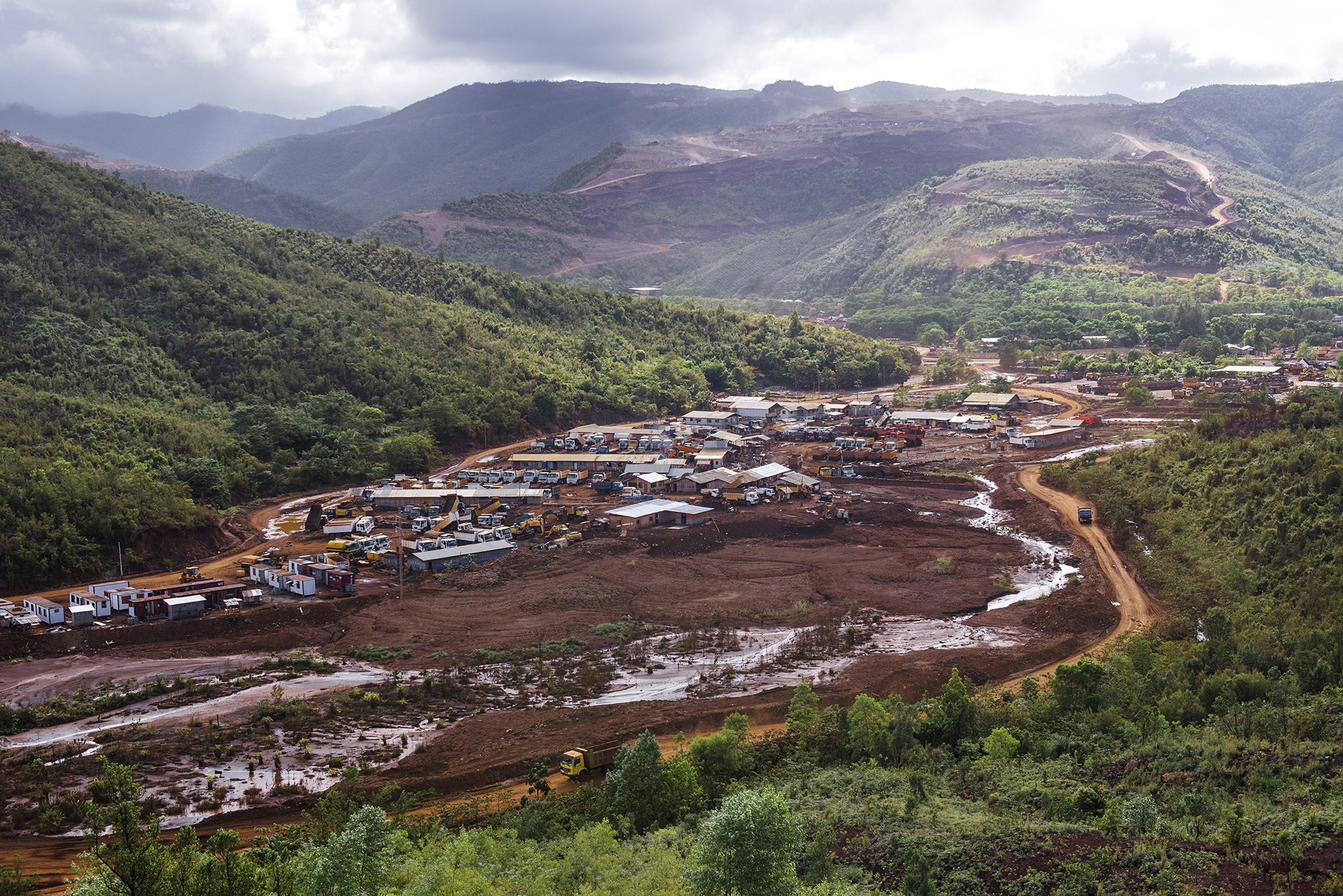 Trucks and heavy equipment stocking zone situated in a mining region of Surigao del Norte, Mindanao, Philippines, 04.2016