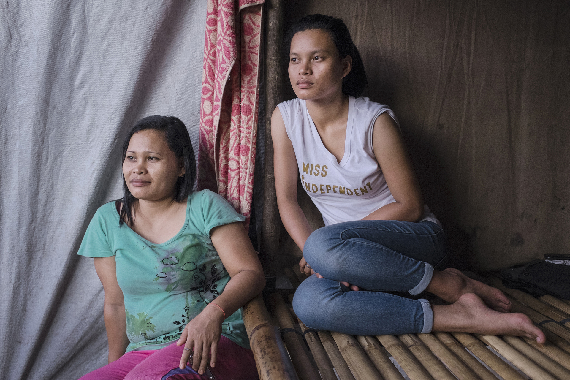 Michele Campos and her mother in a temporary house of the Bakwid evacuation center located in Tandag City, Surigao del Sur, Mindanao, Philippines, 04.2016