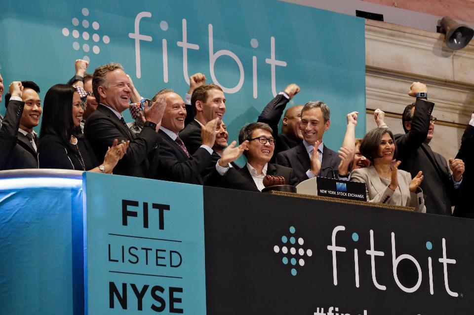 Fitbit CEO James Park, center, is applauded as he rings the New York Stock Exchange opening bell. (AP Photo/Richard Drew)