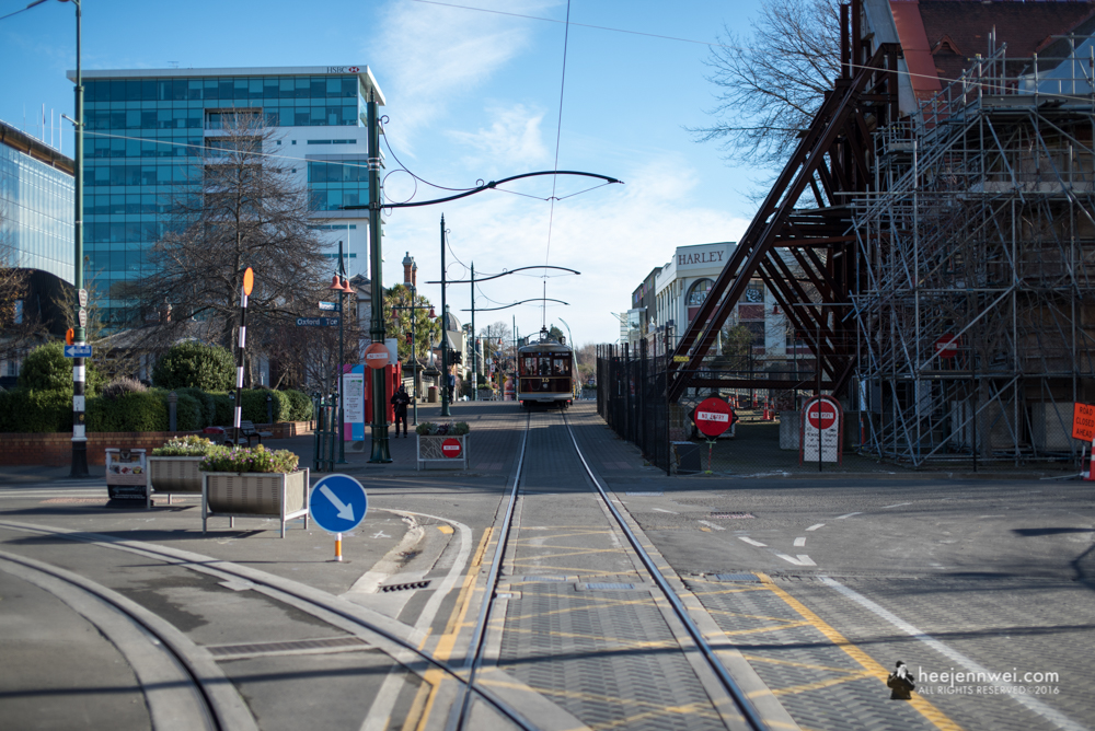 City Tram of Christchurch, with a building under restoration.
