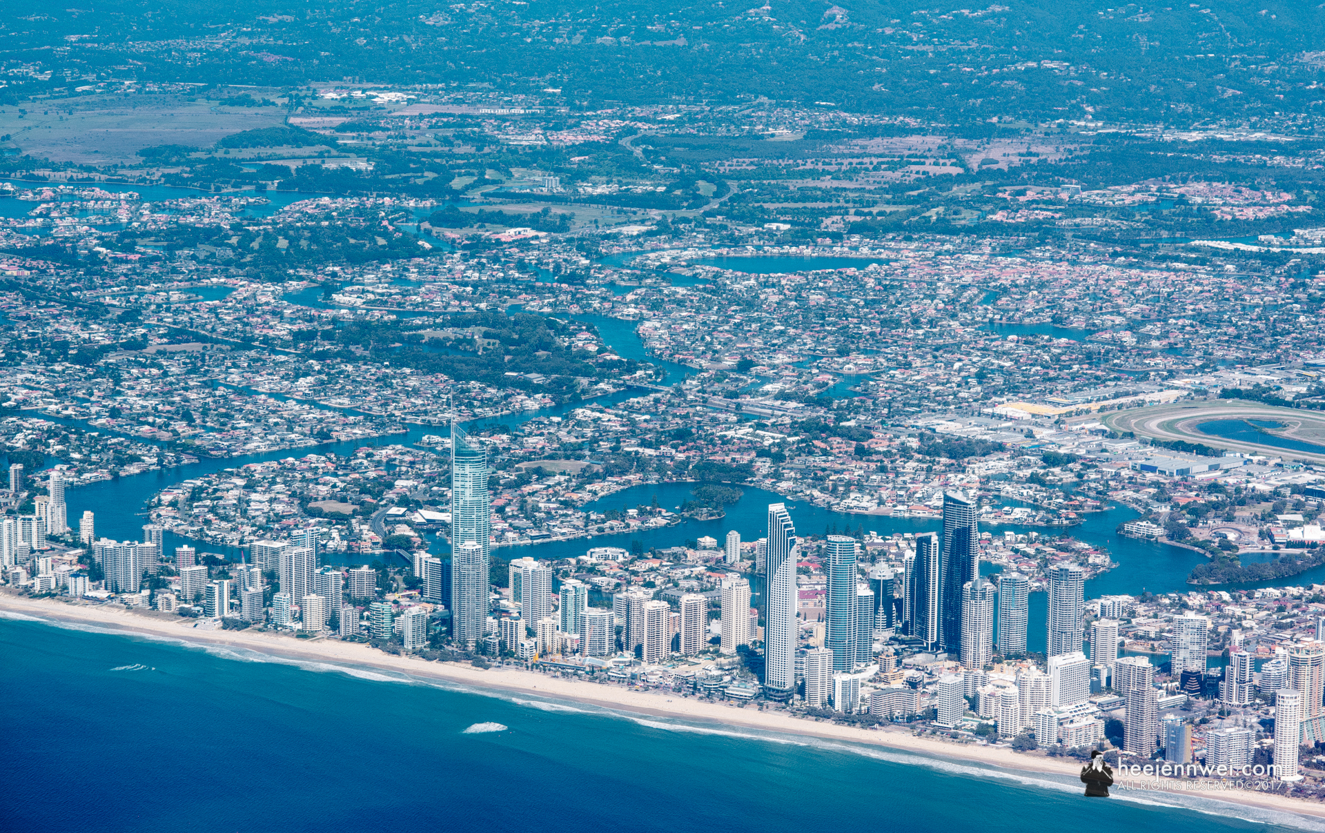 An aerial view of Gold Coast towered over by many high-rises.