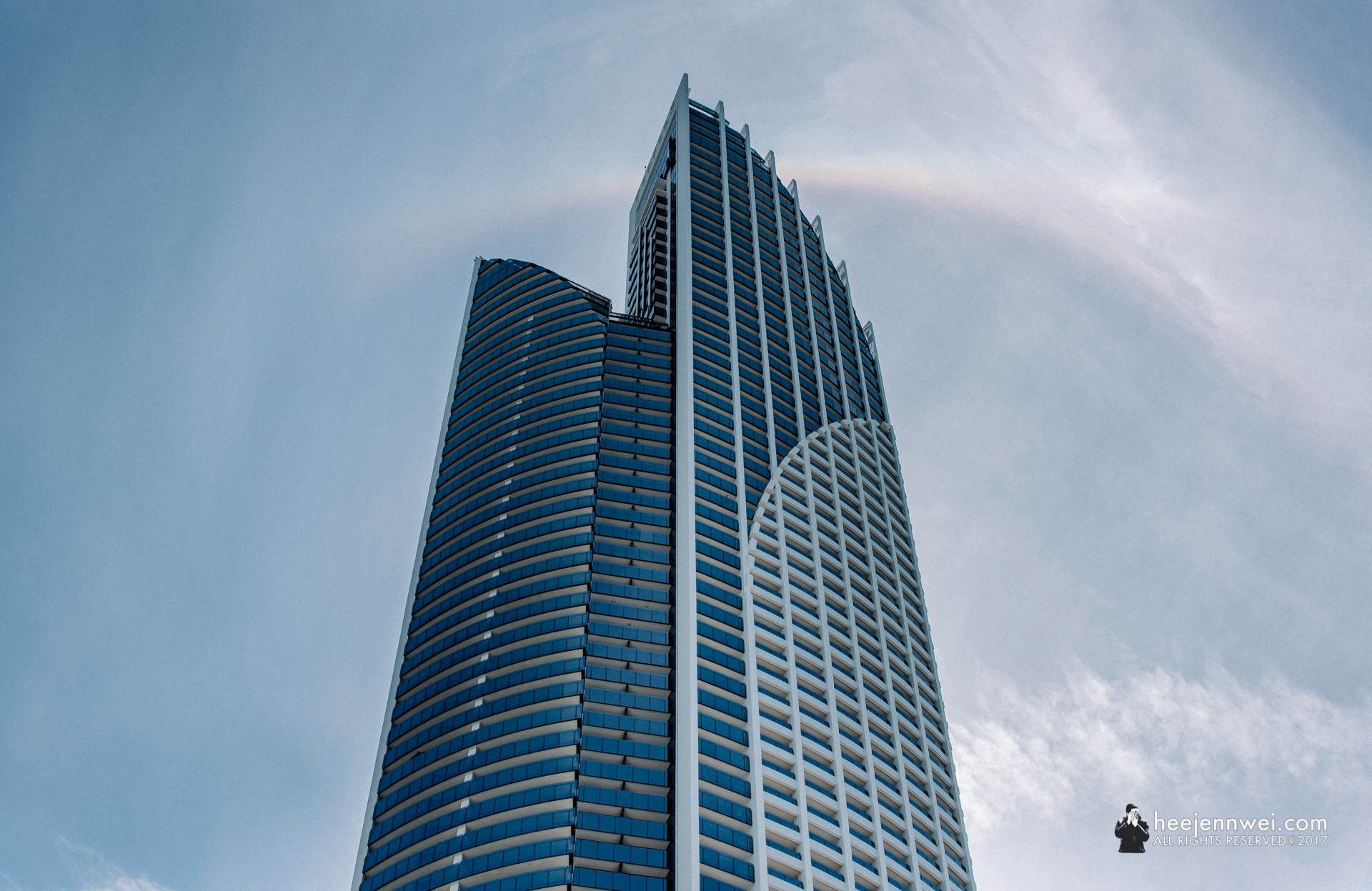 A distant quater circle rainbow formed above Peppers Soul, a luxury condominium located on the Surfers Paradise foreshore with spectacular uninterrupted ocean views.