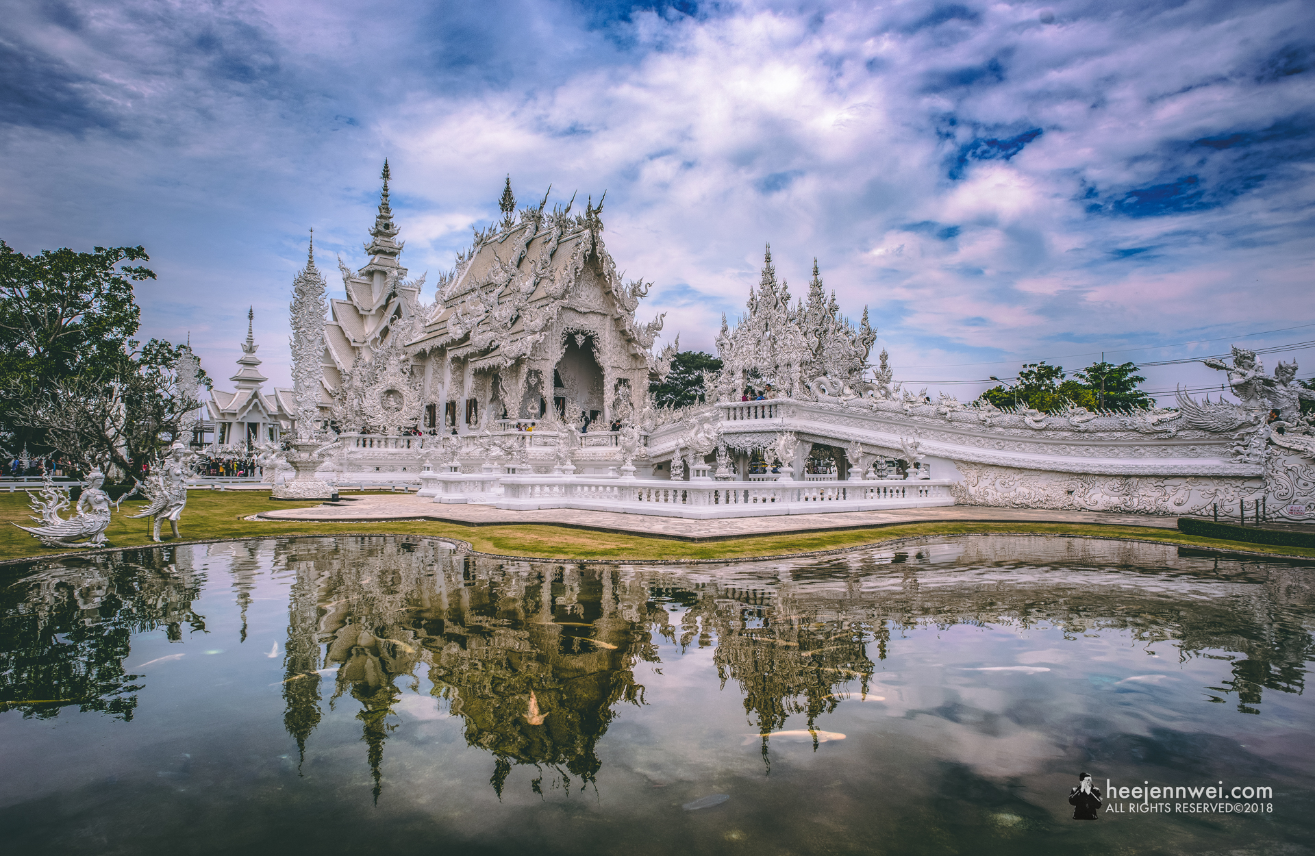 Begin our exploration of Chiang Rai in one of Thailand's most precious gems - Wat Rong Khun.