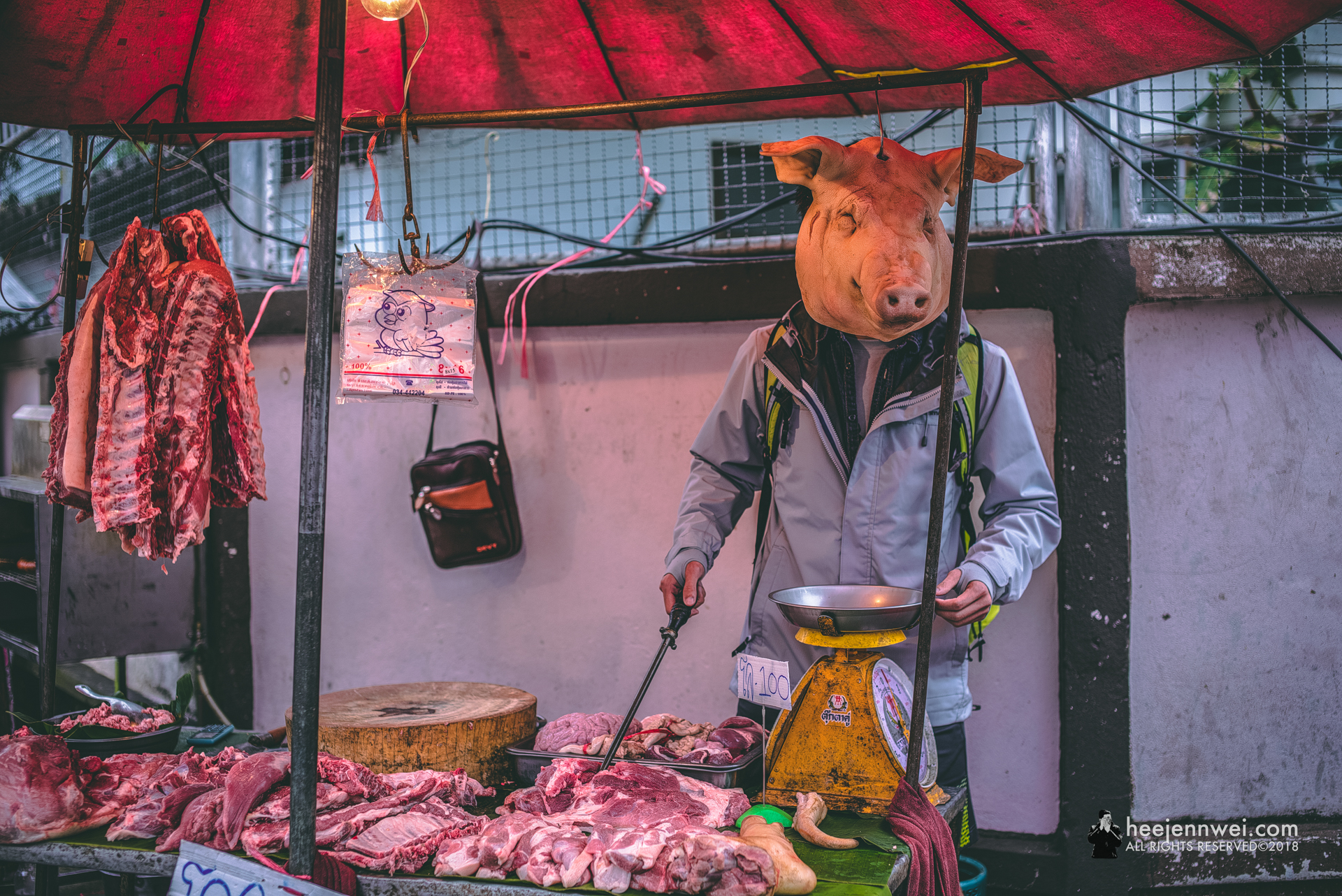 """The wet market vendor was kind enough to have us """"man"""" her butcher stall."""