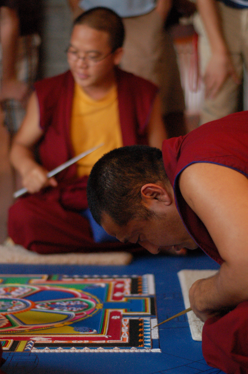 Monks from the Drepong Gomang Monastery in India create a mandala of compassion during the Sacred Arts Festival in 2009.