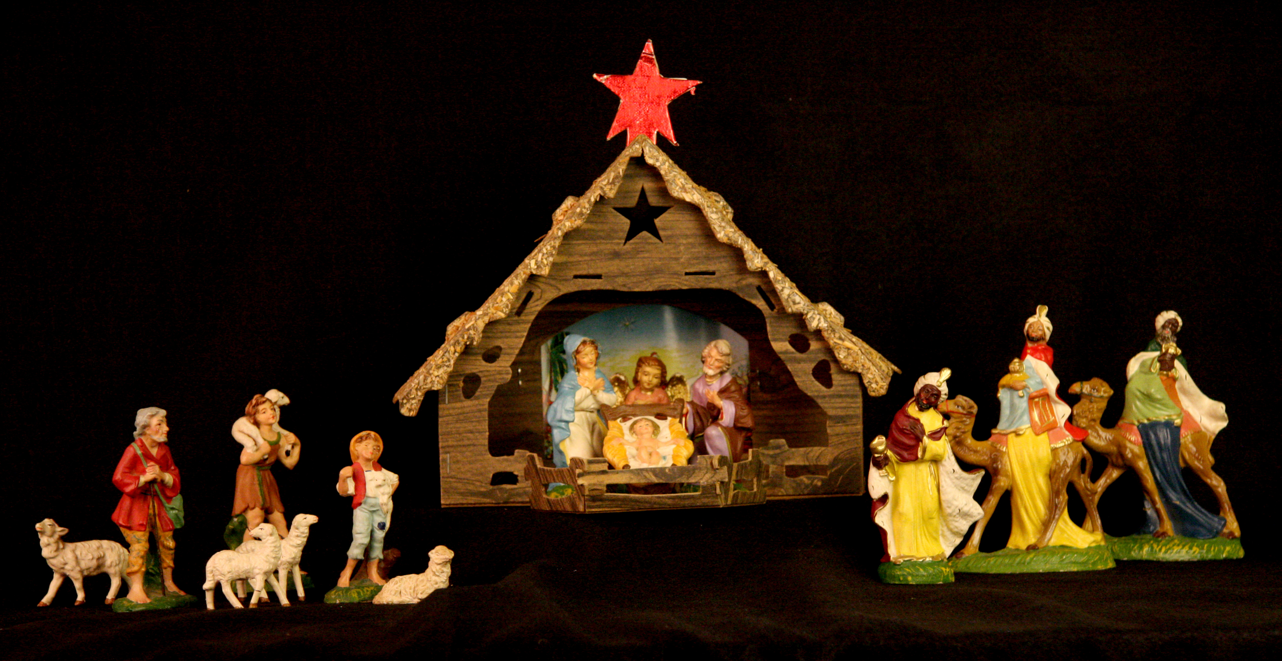 Papier-mache Nativity. Italy (figures), USA (cardboard stable). During the 1950s and 60s, many American families purchased inexpensive Nativity sets like this one at five-and-dime stores like Woolworth's, W.T. Grant, and G.C. Murphy. (Several of the figures in this set have a Murphy's sticker on the base.) Hand painted in Italy, the figures are hollow, with thin papier-mache walls. Most starter sets included the Holy Family, the three wise men, an ox and a donkey, but many different kinds of figures could be bought individually. Nativity sets owned by families were often assembled over a period of years, resulting in figures of different sizes, materials, and countries of origin. Collection of Glencairn Museum.