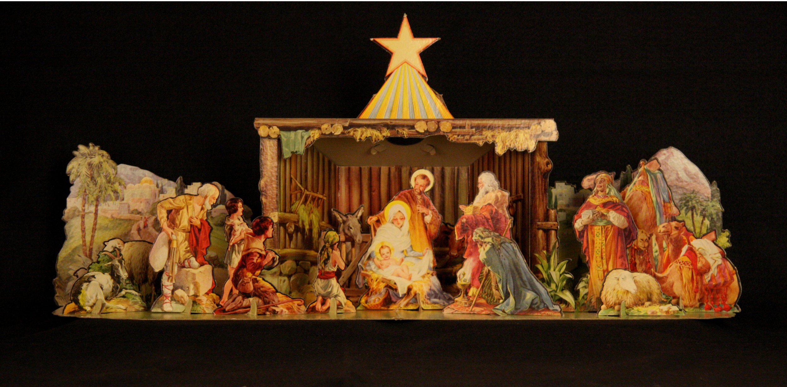 """Christmas Manger Set,"" USA, early 1940s. This cardboard tabletop Nativity was published by Concordia Publishing House from illustrations first produced by artist George Hinke. A base is provided with special tabs to hold the 17 lithographed figures upright; each tab is carefully labeled so that even a child can assemble it. Hinke was born in 1883 in Berlin, Germany, where he trained as a painter. He immigrated to the United States in 1923. Hinke specialized in religious subjects and nostalgic scenes of small-town American life. He is best remembered for his illustrations of children's books such as  Joseph's Story , which tells the Nativity story from Joseph's point of view, and  Jolly Old Santa Claus . Collection of Glencairn Museum."