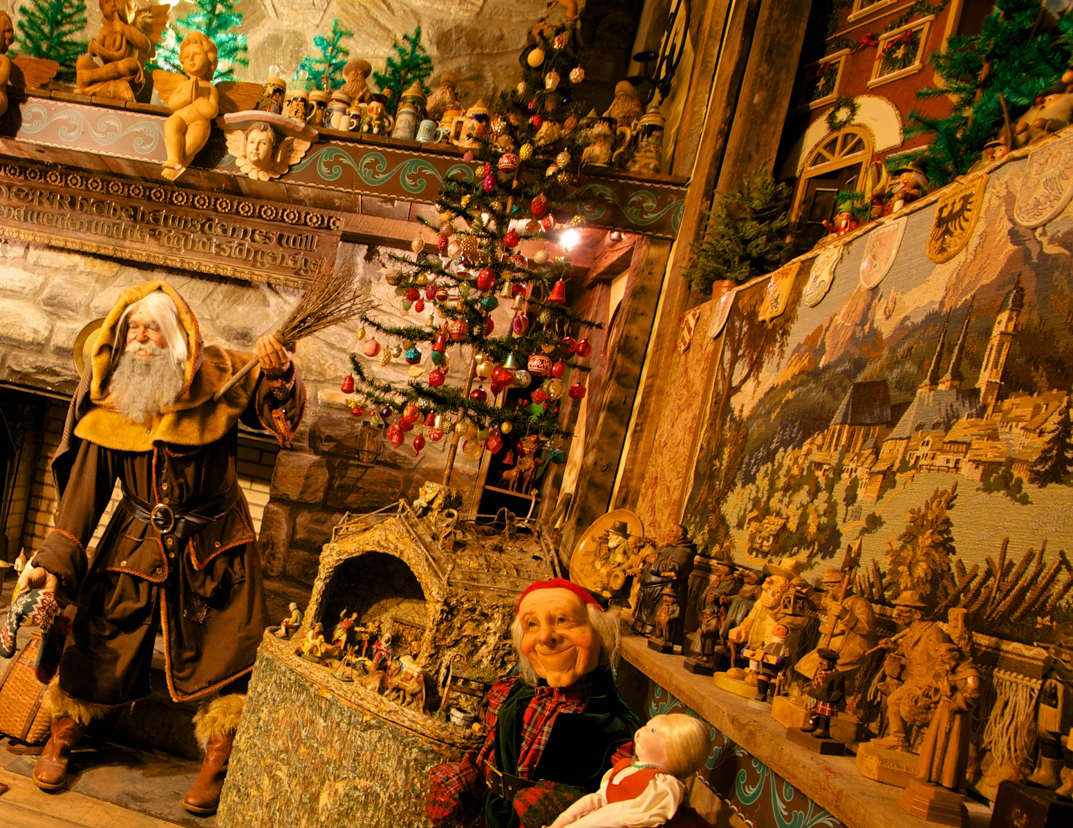 """Figure 2: This exhibit about Christmas traditions in Germany is part of a  Christmas around the World room at the National Christmas Center and Museum. The life-sized figure of the Weihnachtsmann (""""Christmas Man"""") bears more than a passing resemblance to Jim Morrison, founder and curator of the museum. Jim and several others were used as models for some of the figures."""