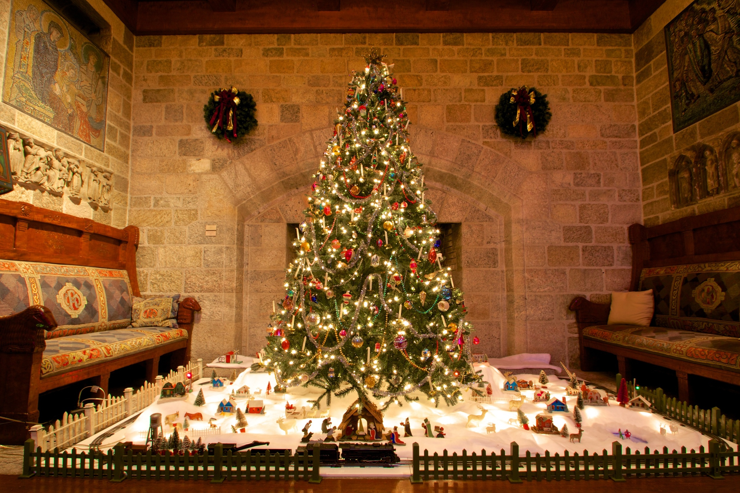 "Figure 1: Glencairn's vintage Christmas tree ornaments and Christmas village decorations were donated in 2011 by Brother Bob Reinke. Brother Bob, whose special love of Christmas has earned him the nickname ""Brother Christmas,"" joined the Brothers of the Poor of St. Francis in 1958. The Nativity scene beneath the tree this year was handmade in the 1930s by a family in eastern Germany, and was part of the village scene beneath their Christmas tree. The operating 1950s Lionel toy train was donated by Louise Chardos of Hoboken, New Jersey. Her brothers Jim, Steve and Hank collected the train and accessories as boys, setting them up annually beneath the family's Christmas tree."