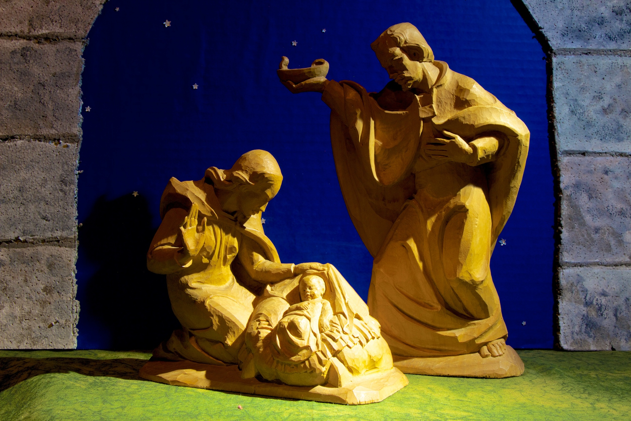 "Figure 2: This Holy Family was carved by Sepp Kals, an academically trained sculptor from Kirchberg in Tirol, Austria. Kals also designed and carved sculptures for several church altars. These Nativity figures were given as Christmas presents by Arthur Compton and his wife to each other. The base of Joseph is inscribed, ""to Arthur Compton from Betty Xmas 1953,"" and the base of Mary is inscribed, ""to Betty Compton from Arthur Xmas 1953."" Arthur was the winner of the Nobel Prize for Physics in 1927. He appeared on the cover of  Time  magazine, and was a key figure in the Manhattan Project."