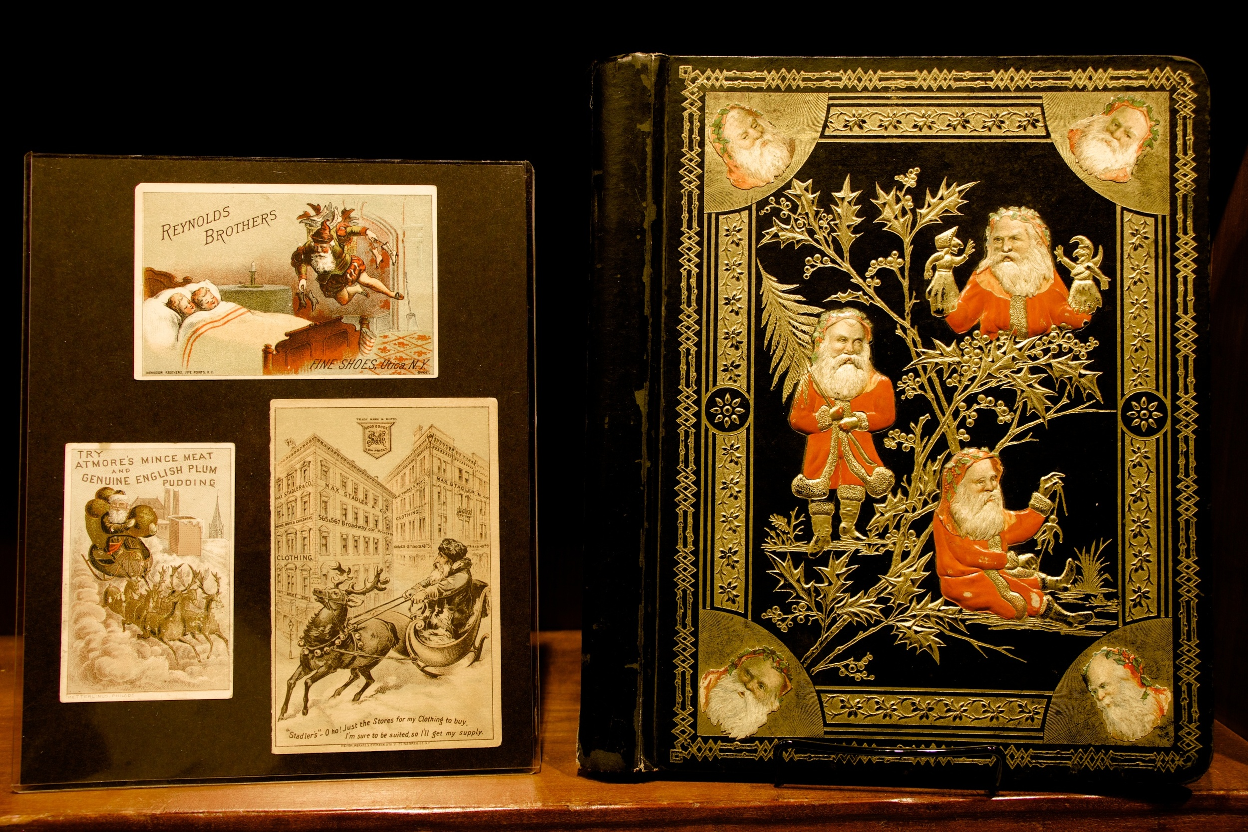 "Figure 13: During the second half of the 19th century, America's growing advertising industry adopted Santa Claus as a ""spokesman"" for a wide variety of products and services. Santa appeared on the covers of souvenir holiday booklets given away by stores and on colorful ""trade cards"" included with purchases. Trade cards were purchased by merchants in bulk, and then overprinted with the name and address of the business, or a specific product, on the front. Trade cards were given to customers throughout the year, but the Christmas-themed cards were the most popular. Many Victorian families cherished them and preserved them in special albums."