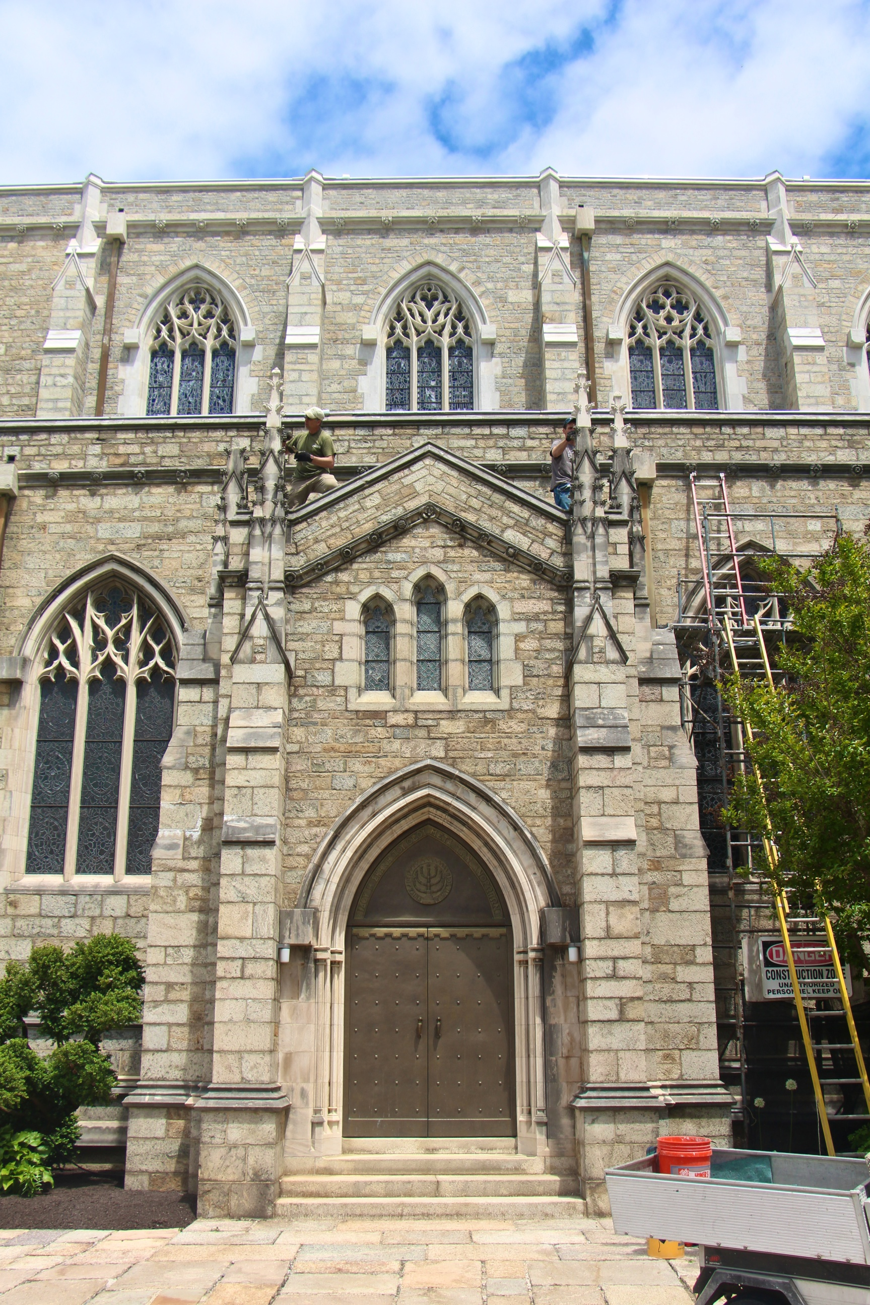 Figure 1: The entry to the south nave of Bryn Athyn Cathedral. The stone work of the upper wall has been completely restored and cleaned. The lower wall, including the stone work for the south entry, is in the process of being restored this year.