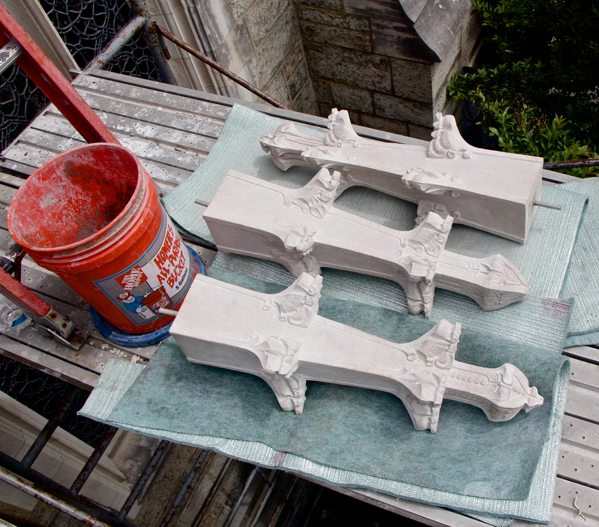 Figure 7: Three completed limestone finials ready for installation above the south entry of Bryn Athyn Cathedral. These will replace the original, badly degraded finials.