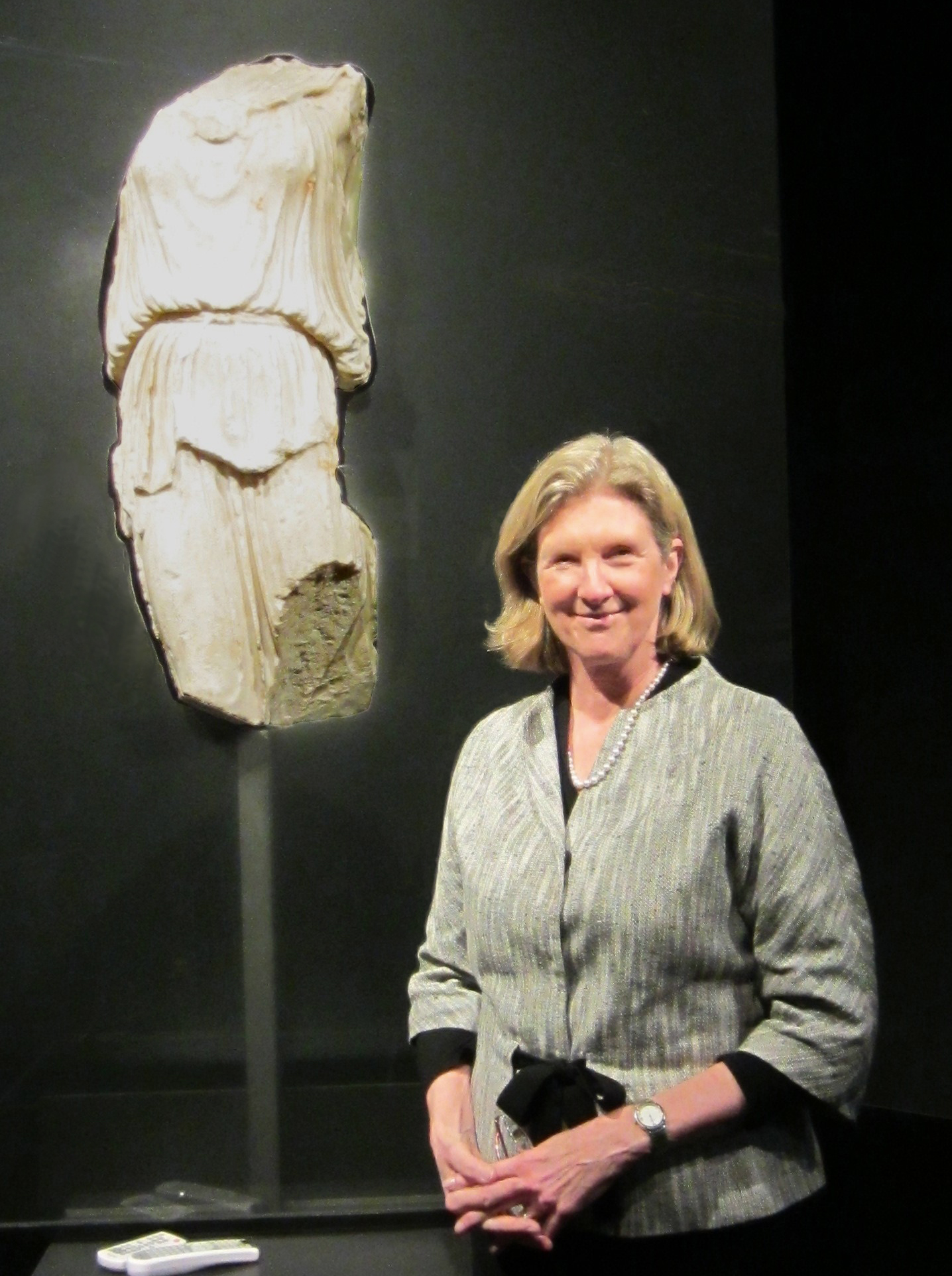 Figure 1: The author, Dr. Irene Bald Romano, with the Sorgente Athena Nike in the exhibition space of the Fondazione Sorgente Group. Photograph by Kenneth Lapatin.