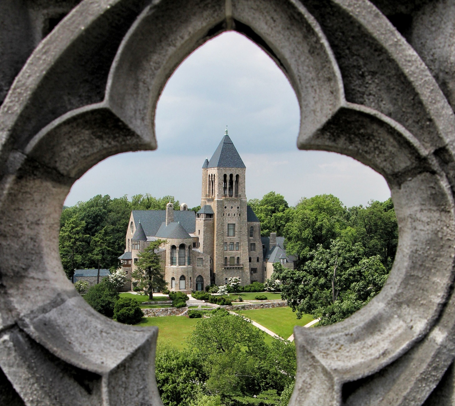 Glencairn viewed through one of the quatrefoils at the top of Bryn Athyn Cathedral.