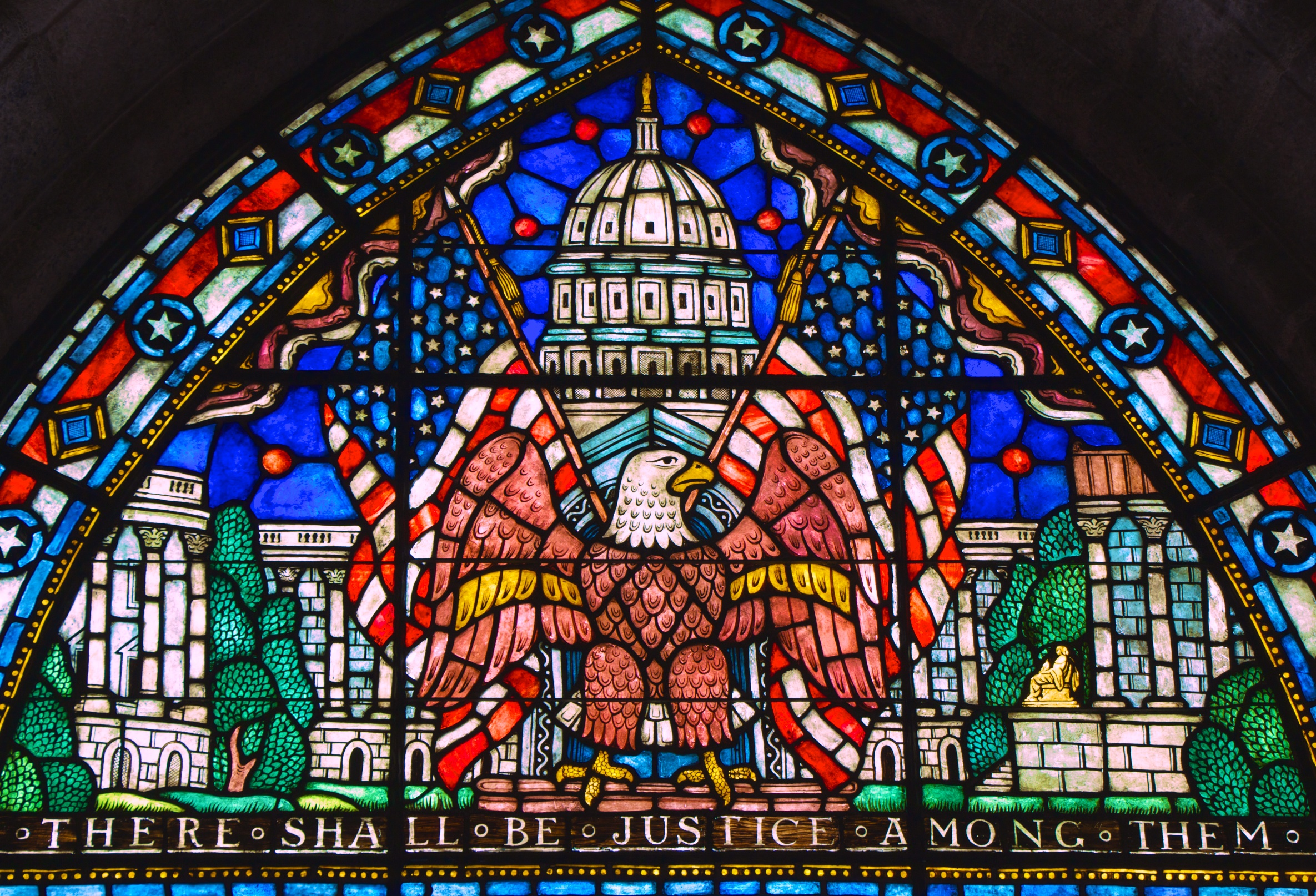 This window in Glencairn's upper hall, made in Bryn Athyn's glass studio and factory, illustrates the balance of power between the branches of the US Federal Government.