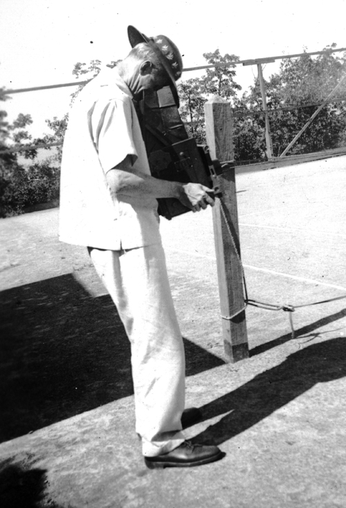 Raymond Pitcairn, circa 1939, with his camera on the Glen Tonche tennis court. Glen Tonche, the Pitcairns' summer home in the Catskills, was one of his favorite spots for taking family photographs. Photograph courtesy of Jennifer Gardner.