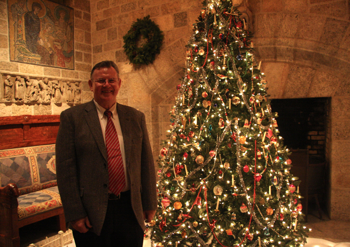 Brother Bob Reinke Poses with His Vintage Tree and Christmas Village