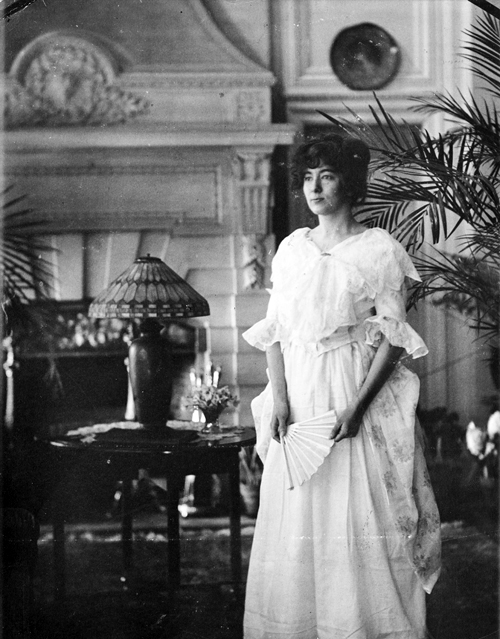Volita Wells Poses in Costume in Cairnwood's Parlor Hall