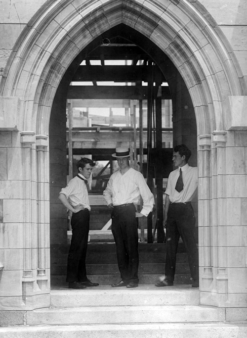 Winfred S. Hyatt, Raymond Pitcairn, and Theodore Pitcairn (left to right), pose in the south porch doorway of Bryn Athyn Cathedral. This photograph is in the collection of the Glencairn Museum Archives, Bryn Athyn, PA.