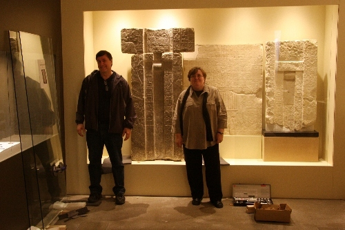 "Ed Gyllenhaal, curator of Glencairn Museum, and Lynn Grant, head conservator at the Penn Museum (University of Pennsylvania), pose with Glencairn's ancient Egyptian ""spirit door"" shortly after its installation at the Roemer- und Pelizaeus- Museum in Hildesheim, Germany."