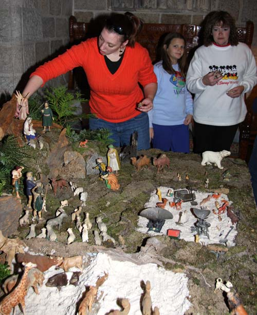 "At the front of the Nativity is a small ""sandbox"" filled with toys, a feature that had been part of the putz when it was owned by the Morris family."