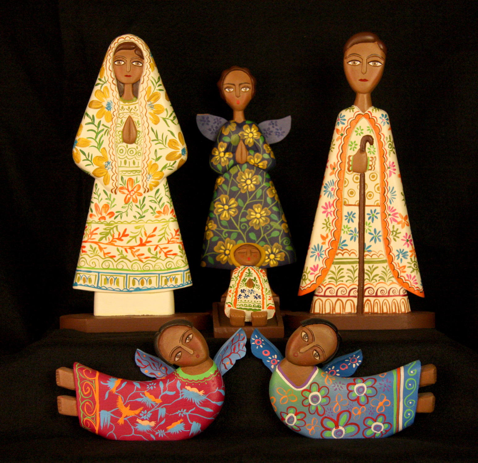 The Jimenez family of Masaya, Nicaragua, carves Nativity figures from cedar wood, which are then brightly painted by local artists. The father, mother and children are all involved in the process. In addition to the Holy Family, this Nativity includes the wise men and a heavenly host of twenty angels.