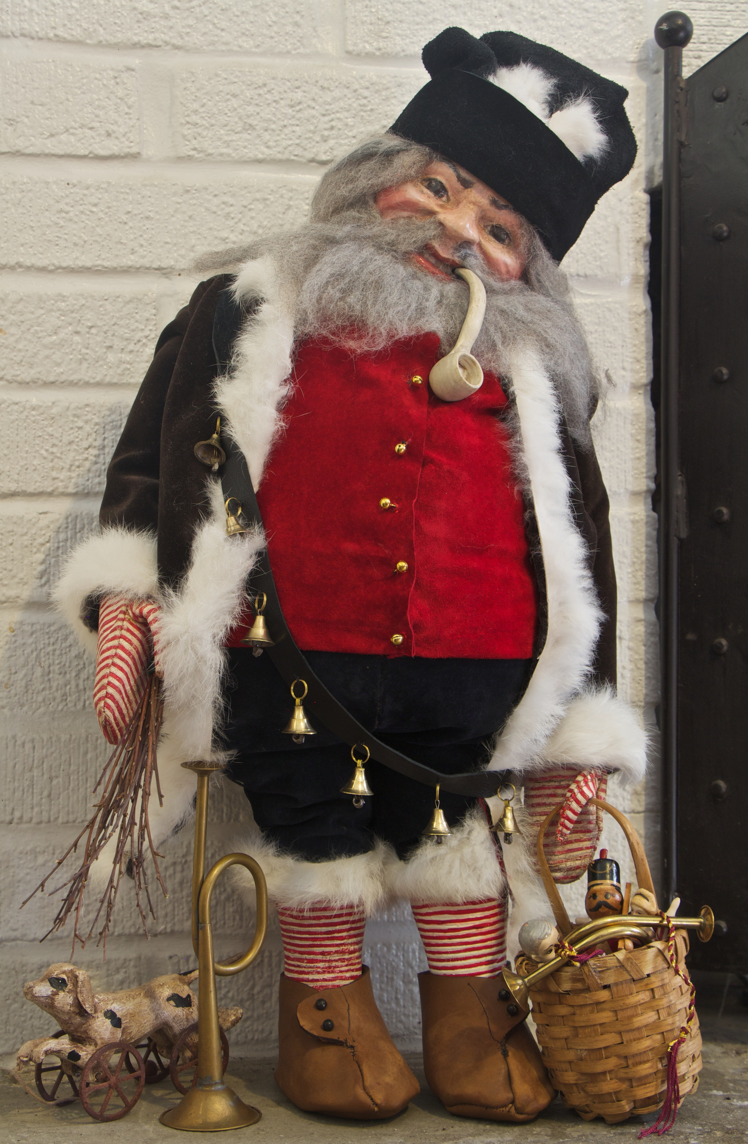 """Belsnickel (sometimes translated """"St. Nicholas dressed in fur"""") was a Christmas gift-giver in early Pennsylvania Dutch communities, making the rounds from farmhouse to farmhouse. Belsnickel brought treats or presents for obedient children, but was ready with a rod or switch to punish naughty ones."""