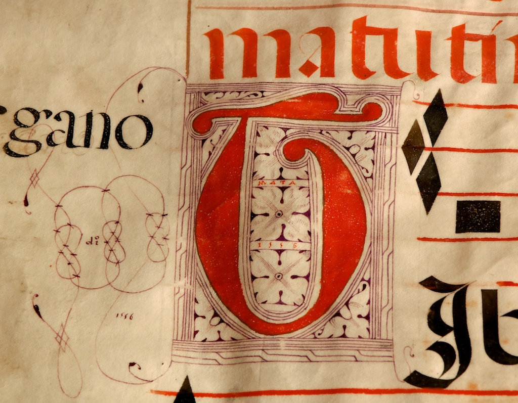 """Figure 4: The illuminated letter """"T"""" on folio 144v includes the name """"Mata"""" as well as two mentions of the date 1556."""