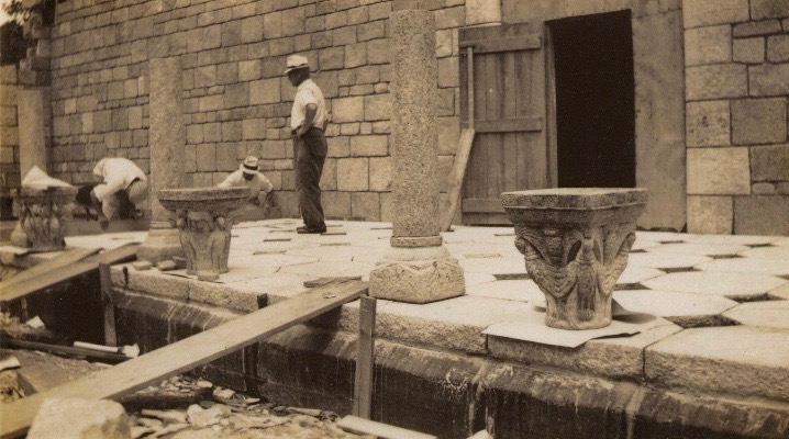 Figure 6: Glencairn's cloister during construction. The temporary wooden door in the photograph is on the east side of the cloister; today this is an ornate copper door providing entry to the Great Hall. Glencairn Museum Archives.
