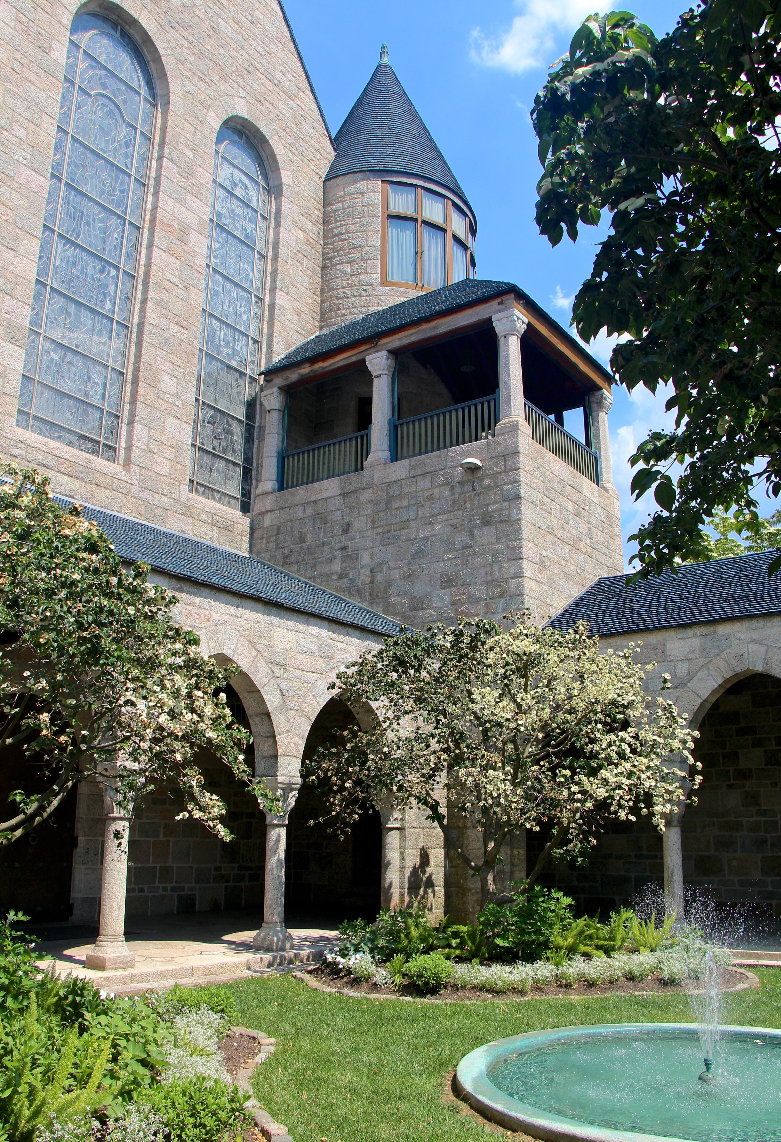 Figure 9: The southeast corner of the cloister. The covered porch above the cloister roof is a sleeping porch attached to the master bedroom and bath.