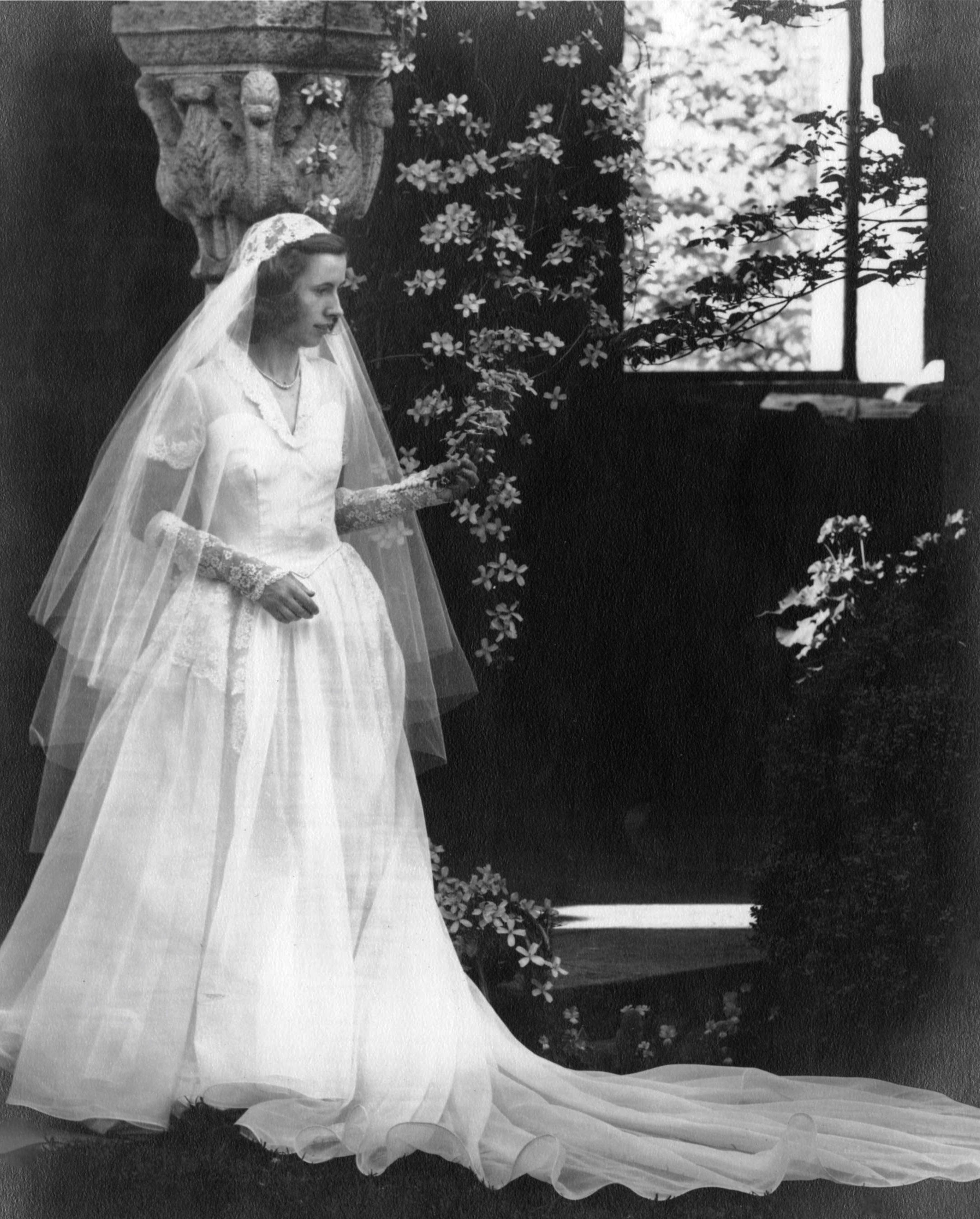 Figure 8: Eleanor Stroh (Hansen), who worked at Glencairn for the Pitcairn family, was photographed in the cloister in 1951 in her wedding dress. The wedding dress was a gift from the Pitcairns. Glencairn Museum continues the tradition of   wedding photography in the cloister  .