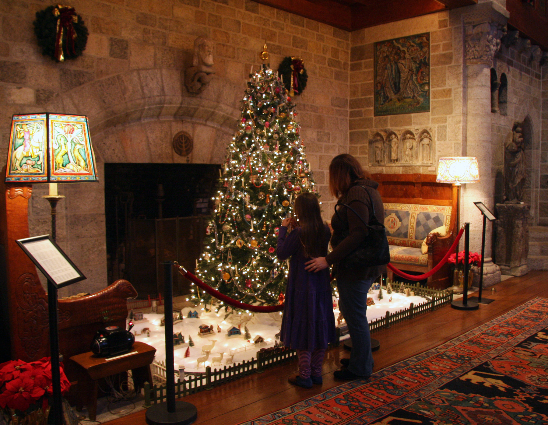 Visitors to the 2015 year's Homeschool Days enjoy Glencairn's Christmas tree, decorated with vintage and antique ornaments. Brother Bob Reinke, a Franciscan friar in Hoboken, New Jersey, spent half a century collecting the ornaments. The village beneath the tree includes an operating 1950s Lionel toy train.