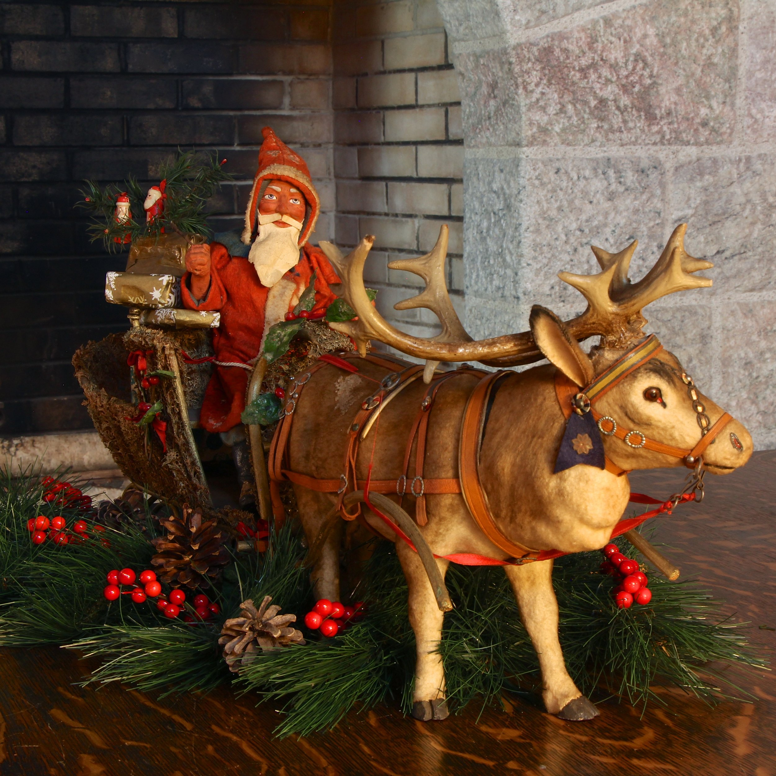 "This Santa, sleigh and reindeer, probably dating to the 1920s, was discovered in a basement storage room in 2016. Old photographs show the decoration being used as the centerpiece for the Pitcairns' Christmas dinner table. The head of the reindeer comes off to reveal a silver-colored cardboard compartment for holding candy. This well-known class of German candy containers is prized by collectors. Visitors to Glencairn Museum will be able to see the candy container on the ""Christmas in the Castle"" guided tour, running from Friday, November 25, 2016 through Sunday, January 8, 2017."