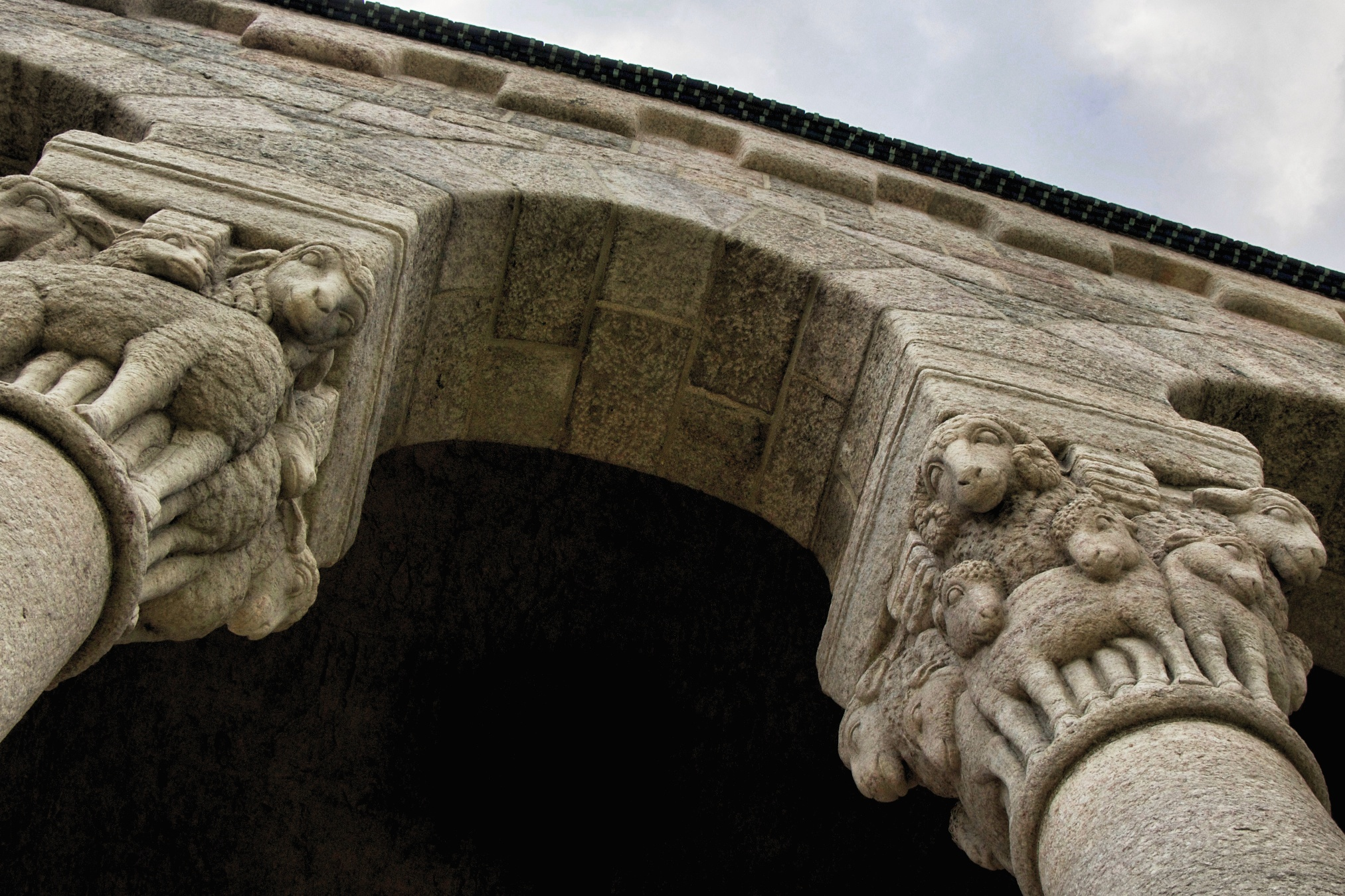 Figure 5: Two large capitals depicting families of rams, ewes, and lambs help support the roof on the south side of Glencairn's tower.