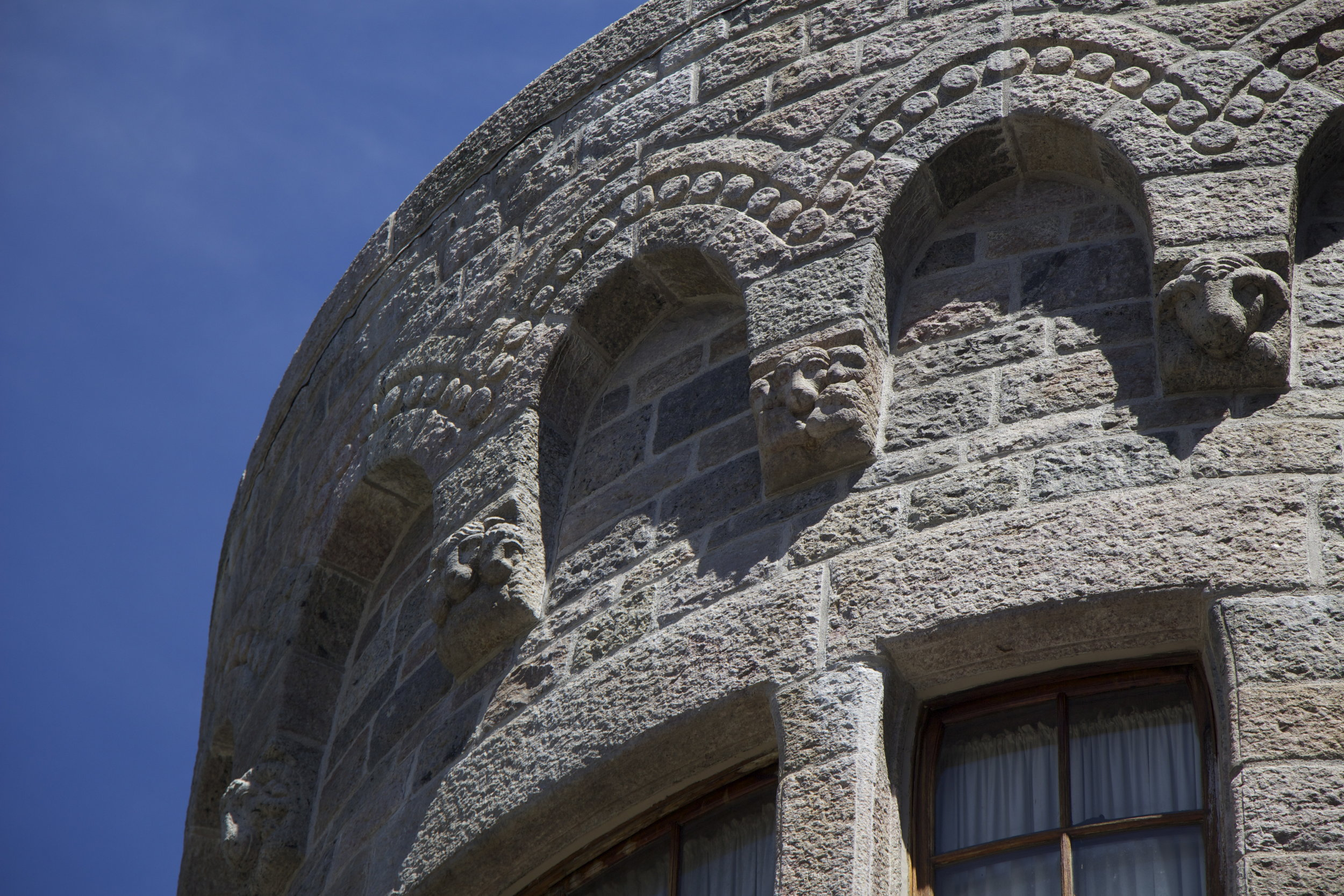 Figure 6: Multiple carvings of sheep decorate the exterior stone fabric of Glencairn.