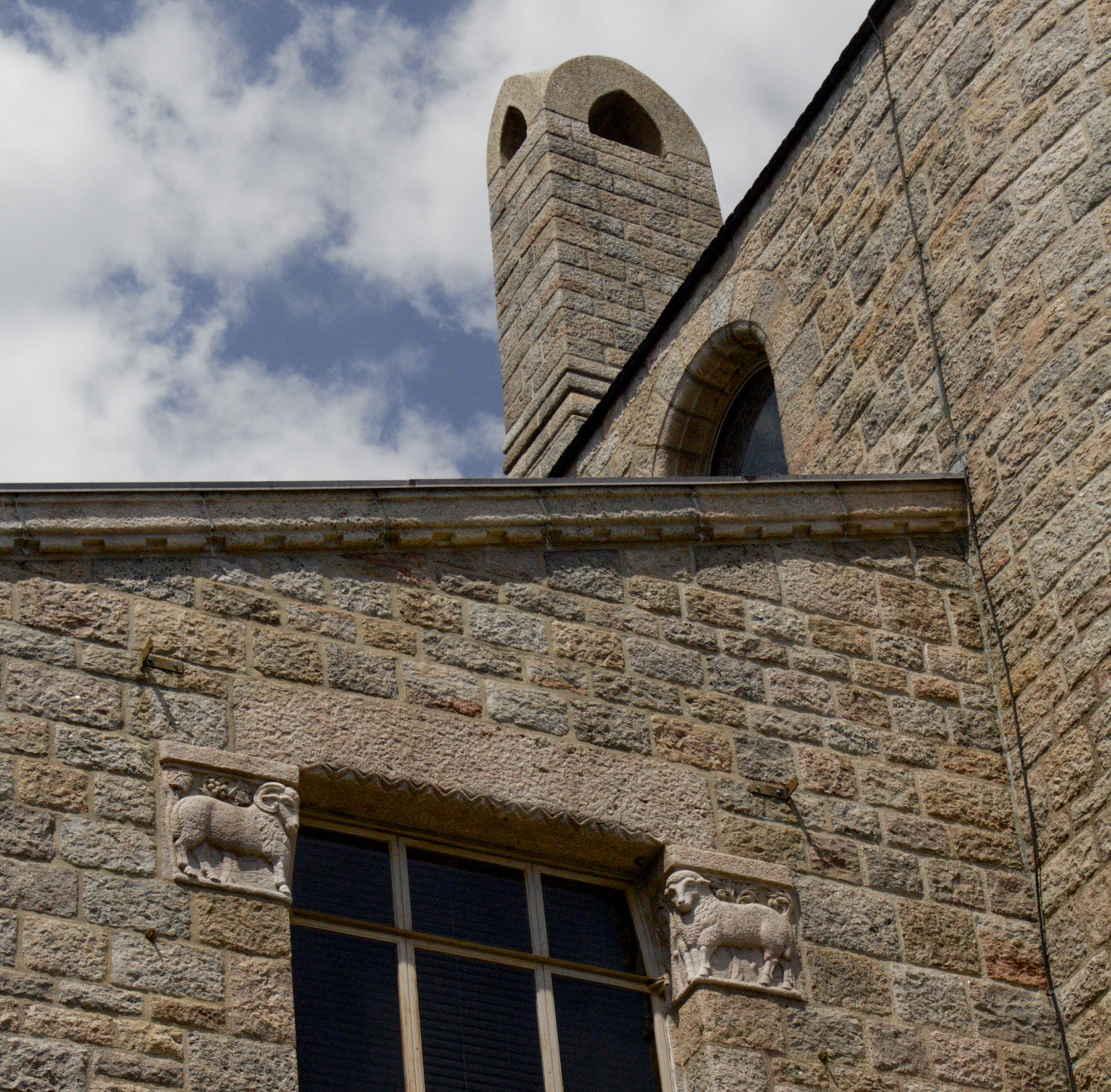 Figure 8: A ram and ewe face each other outside the window of Glencairn's master bedroom on the third floor.