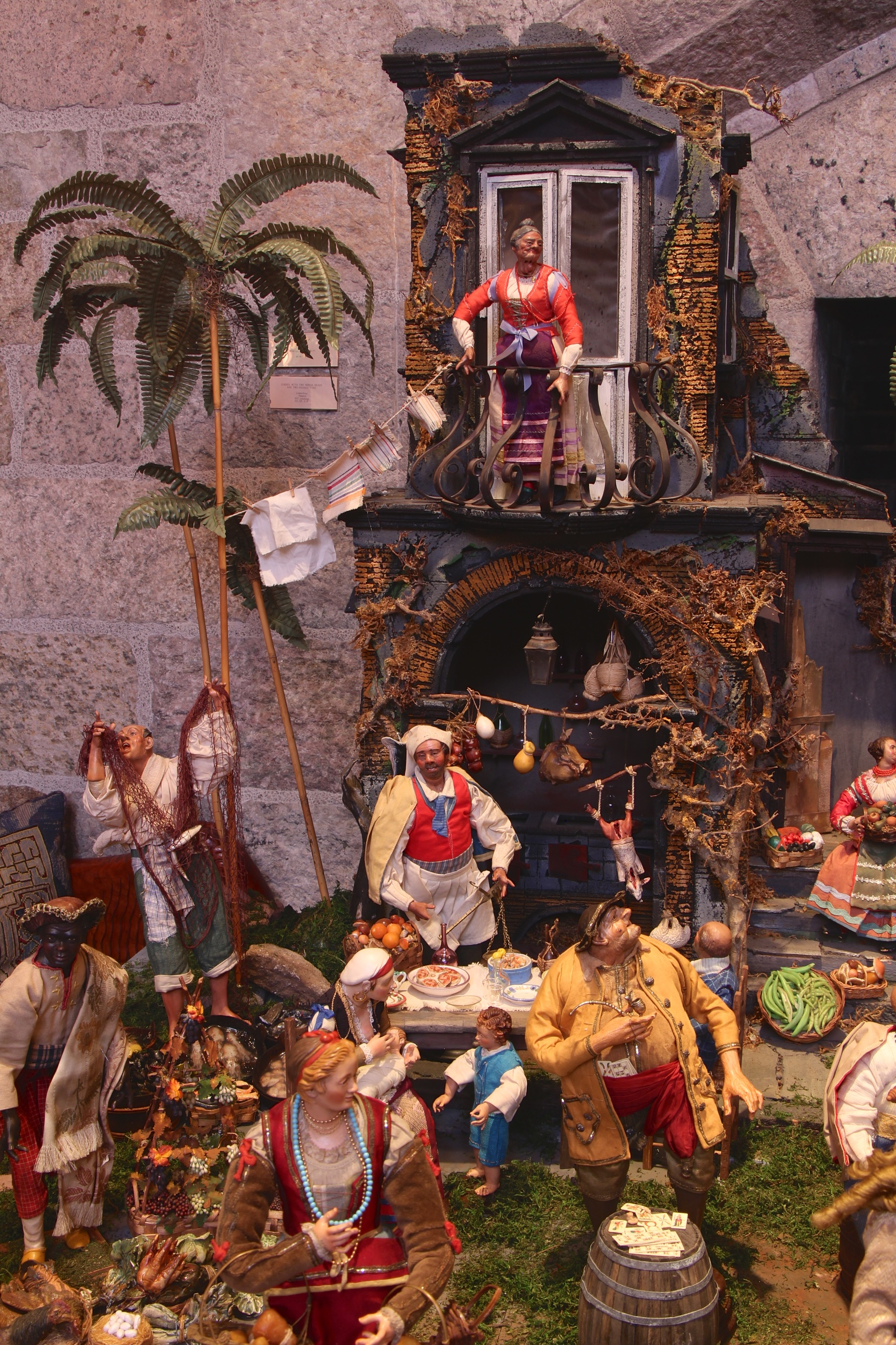 Figure 3: According to the biblical account, Mary and Joseph were turned away from the inn at Bethlehem. The inn scene in this Presepio, which includes several unsavory characters, is located as far as possible from the Holy Family.
