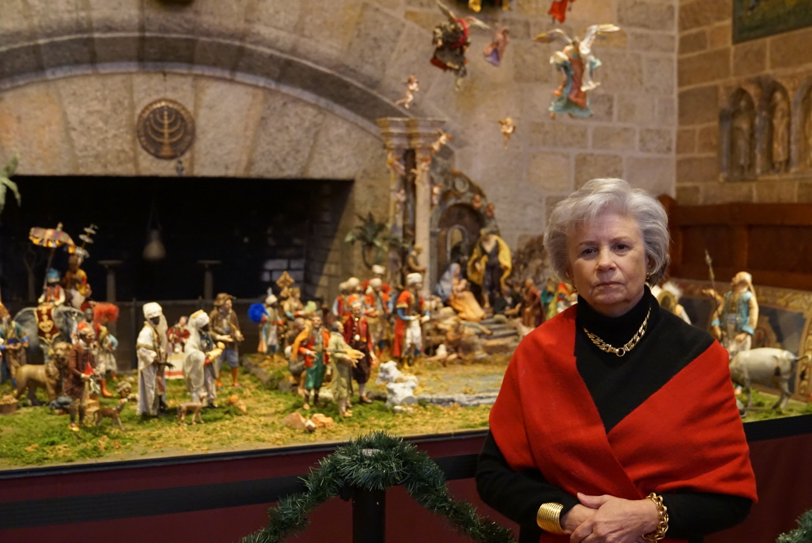 Figure 6: Marcia Evans at the opening of Glencairn's  World Nativities  exhibition. Marcia and her sister Suzanne Hoyle-Rhodes donated the Presepio to the Fleisher Art Memorial in memory of their sister Elizabeth Anne Evans. Elizabeth collected the figures and structures over a period of more than thirty years during her annual trips to Naples, Italy.