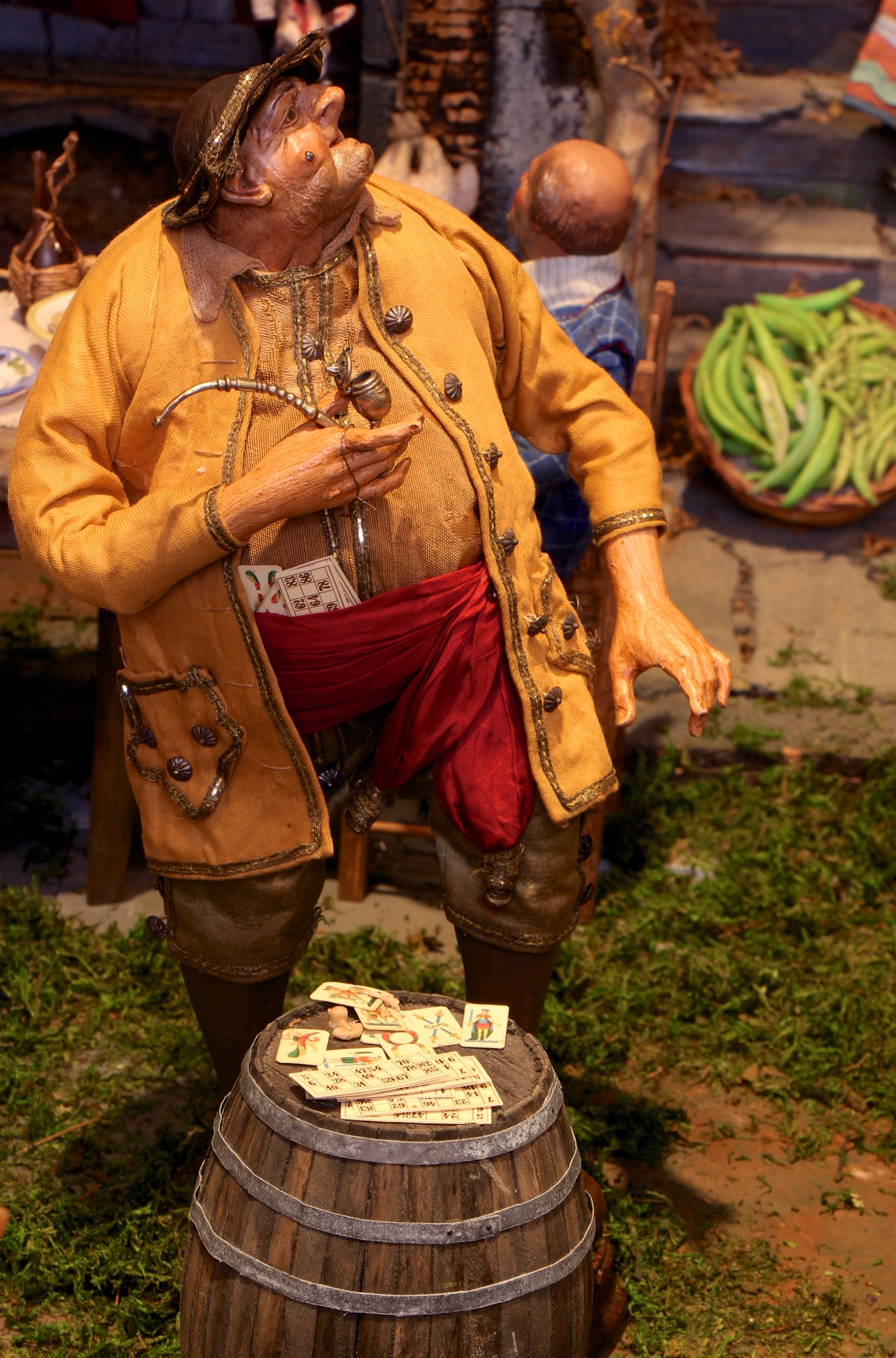 Figure 10: Outside the tavern, a gambler smokes his pipe and tries to lure people into a game. Extra cards are hidden inside his cummerbund.