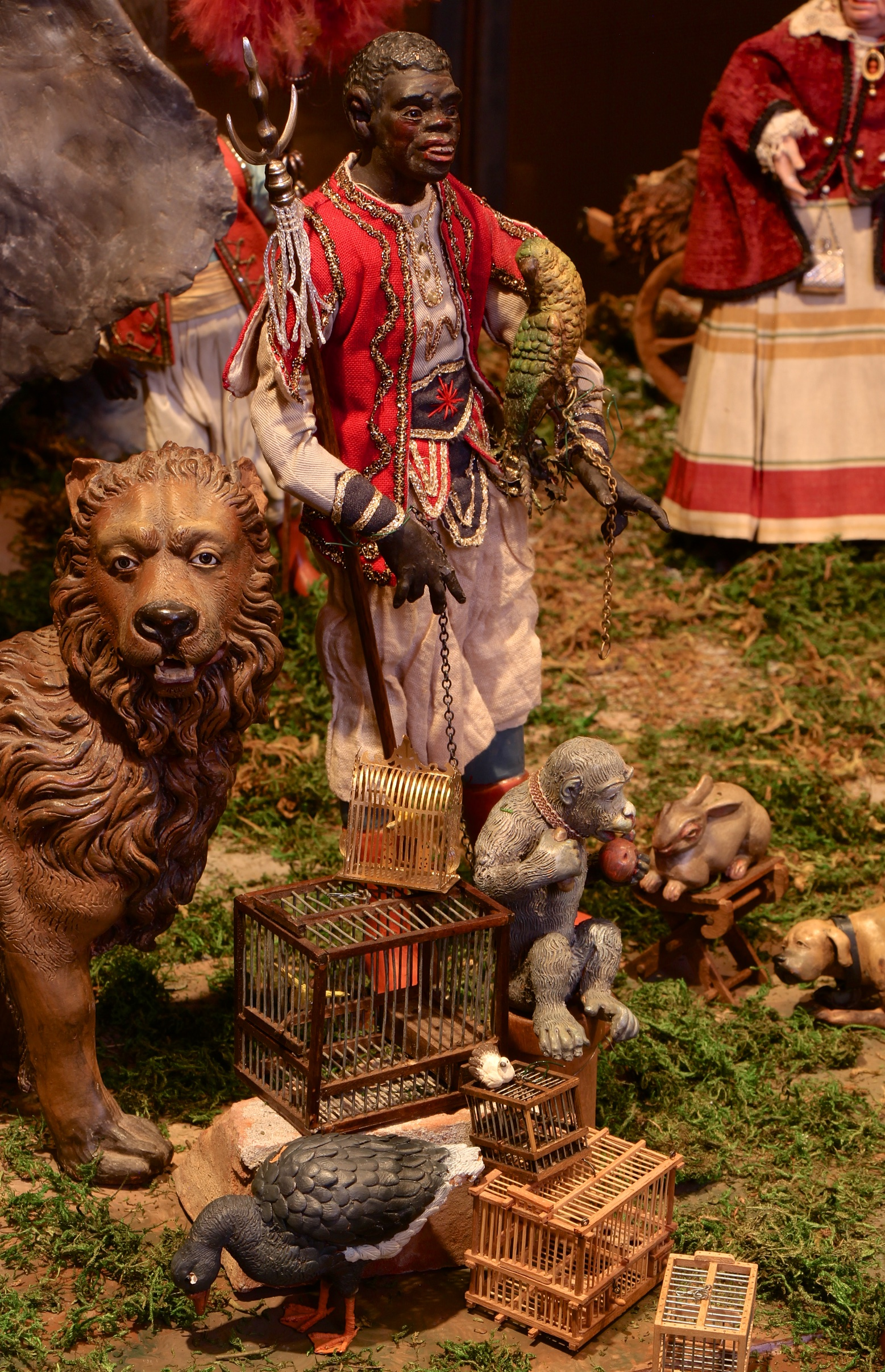 Figure 14: The vendors seem more concerned with their sales than with the excitement at the Roman ruins. An exotic animal vendor with a parrot on his arm restrains a monkey with a leash.