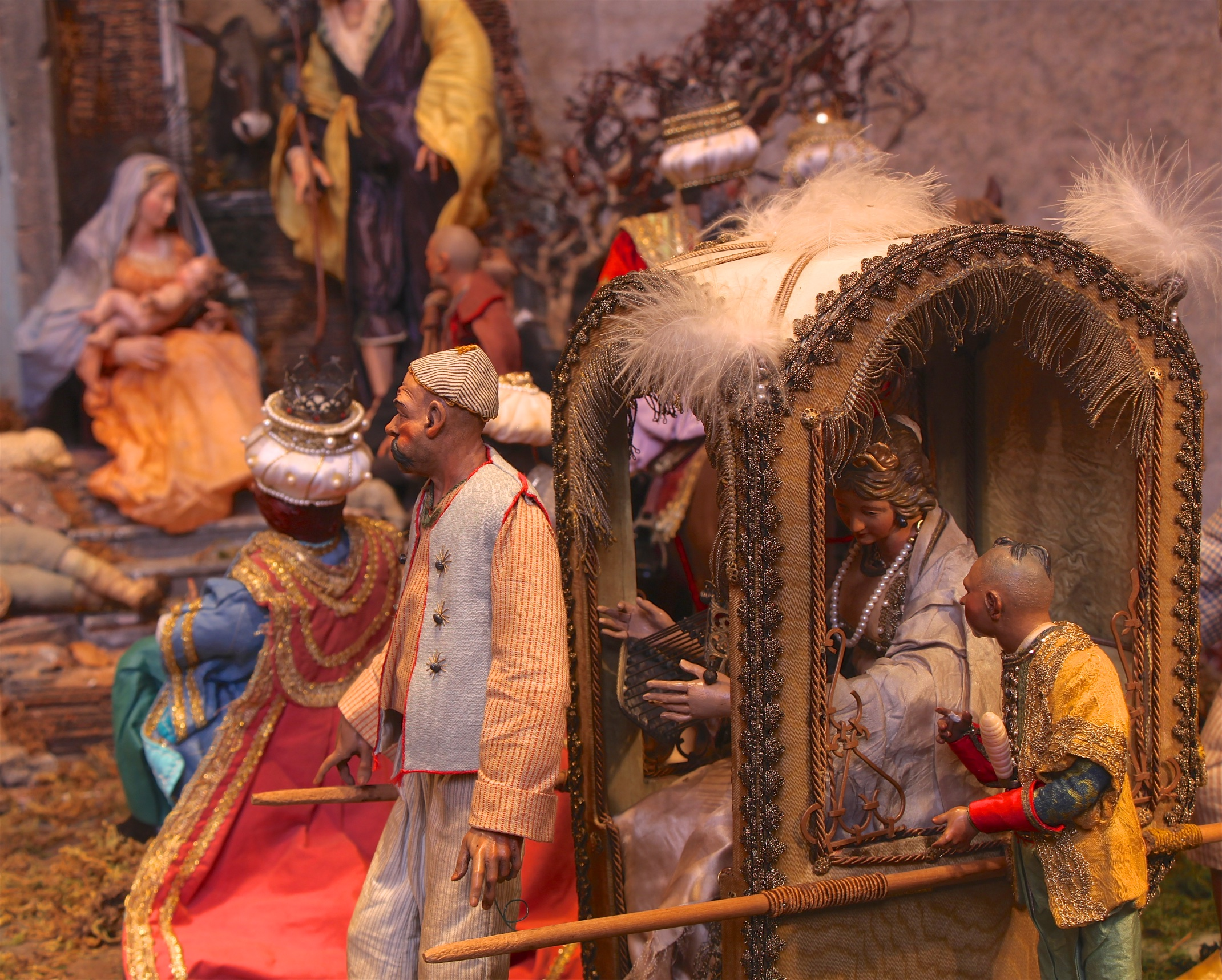 Figure 17: All segments of society, rich and poor, are present in a Neapolitan Presepio. An aristocratic lady arrives at the Nativity scene in a sedan chair, carried by attendants.