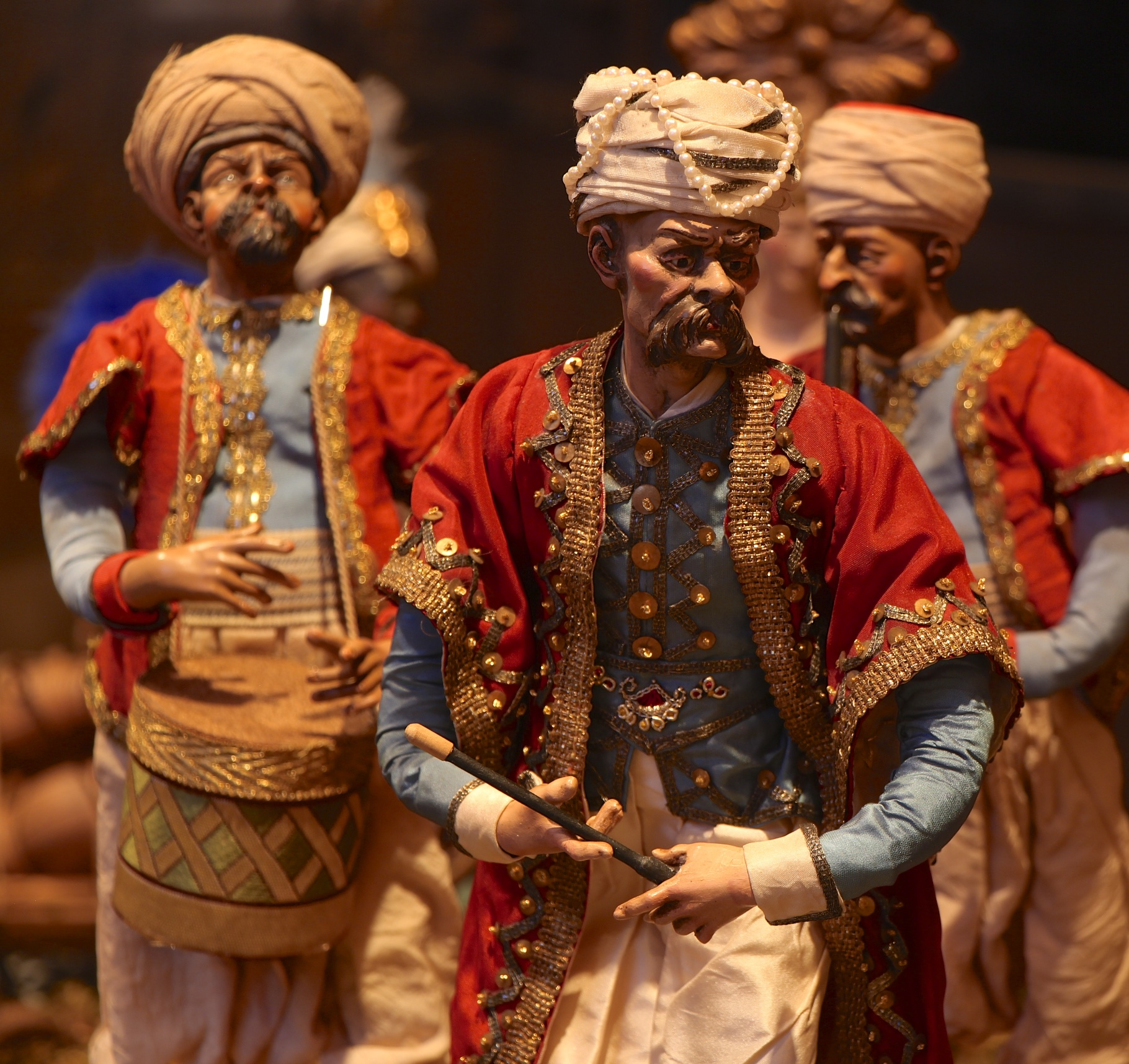 Figure 19: A Turkish band plays in celebration of the miraculous event. Sometimes in Presepi these foreign bands were considered part of the retinue of the wise men, but they were a common sight in 18th-century Naples.