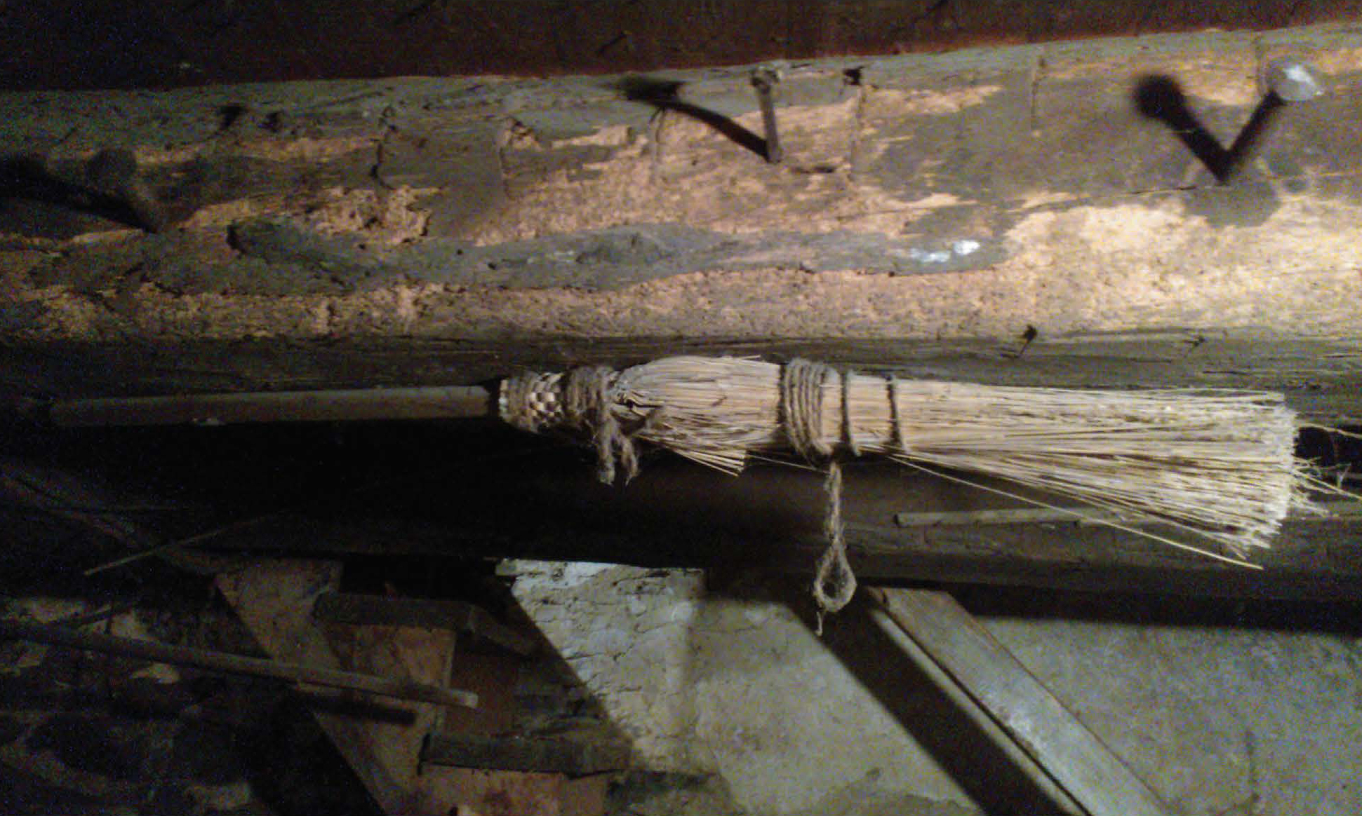 Figure 30: A concealed broom in a Berks County farm house, nailed to a floor joist visible by the basement stairs. Private Collection, photo courtesy of Patrick J. Donmoyer.