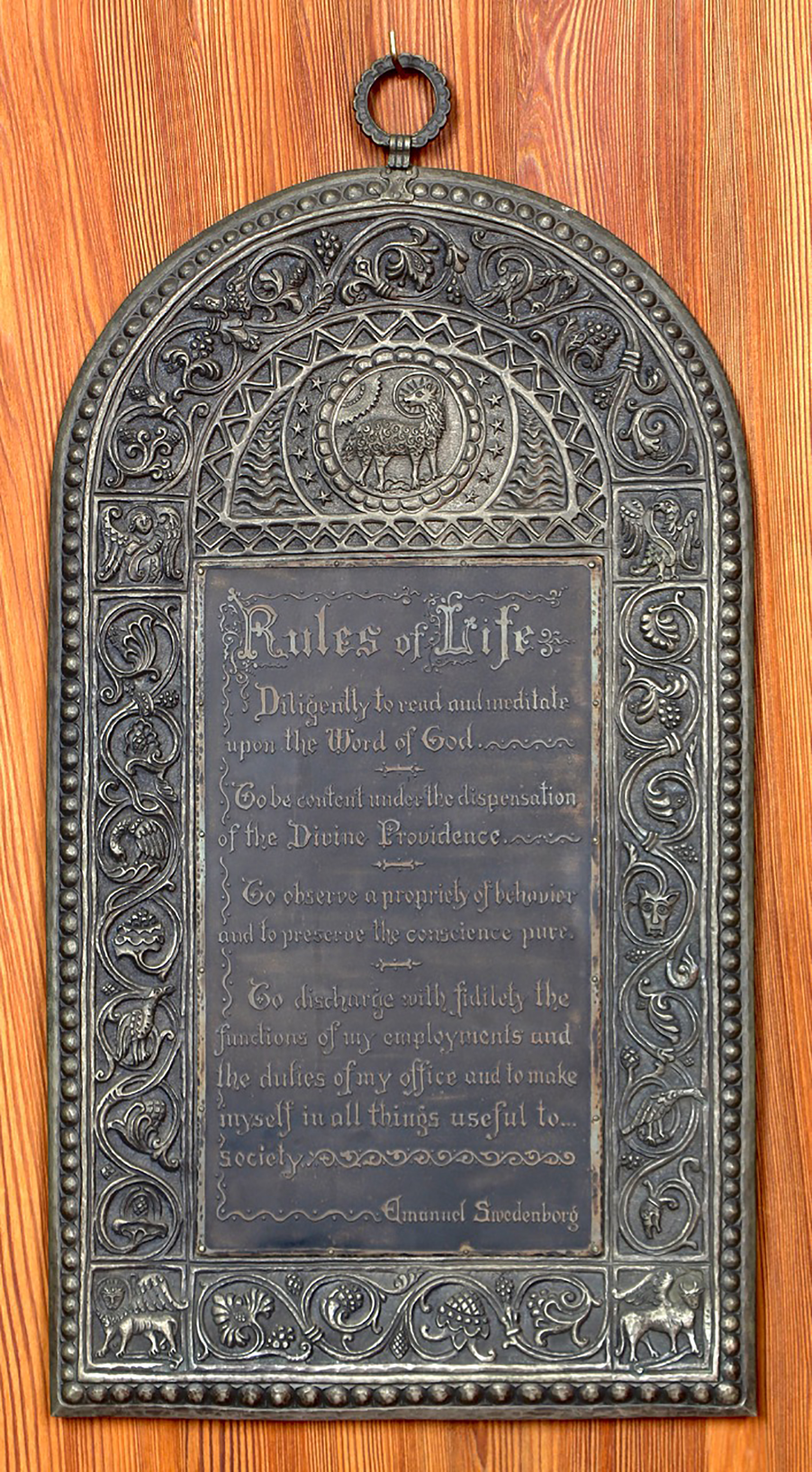 "Figure 6: A plaque with Emanuel Swedenborg's ""Rules of Life,"" made from monel metal, hung on one of the walls of Cairnwood's chapel. The plaque was commissioned by Raymond Pitcairn and made by John Joseph Walter, who also did metalwork for Bryn Athyn Cathedral. The text reads: ""Diligently to read and meditate upon the Word of God. To be content under the dispensation of the Divine Providence. To observe a propriety of behavior and to preserve the conscience pure. To discharge with fidelity the functions of my employments and the duties of my office and to make myself in all things useful to society."""
