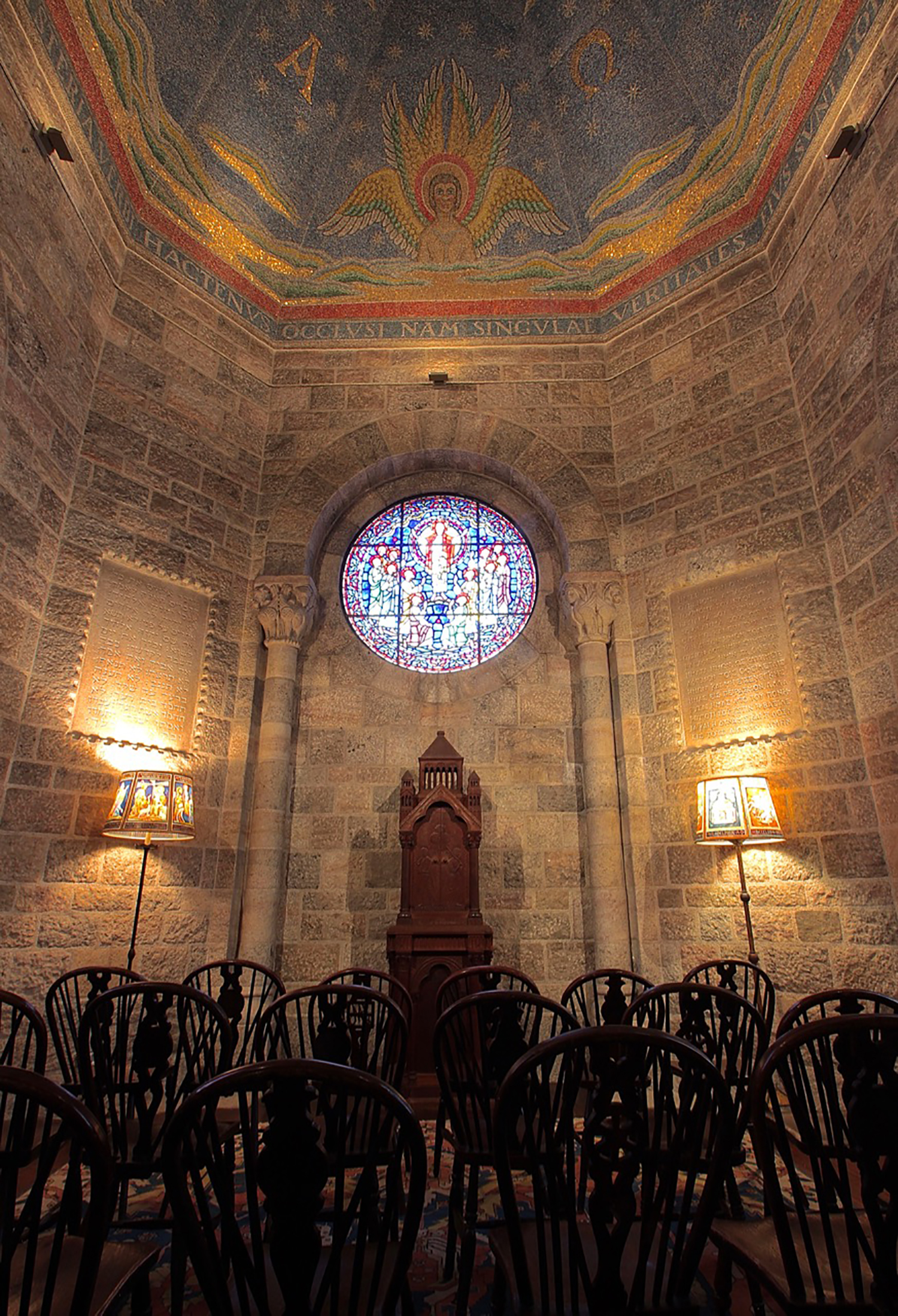 Figure 9: Front and center in Glencairn's chapel is a cherrywood Bible cabinet, designed and carved in the Bryn Athyn Studios. In New Church worship services, the Bible is opened at the beginning and remains open until the end.