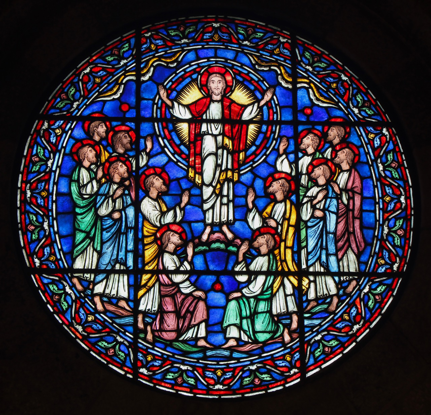 Figure 14: In a central position on the east wall, this roundel window, made in the Bryn Athyn glassworks, features Jesus Christ and the twelve apostles.
