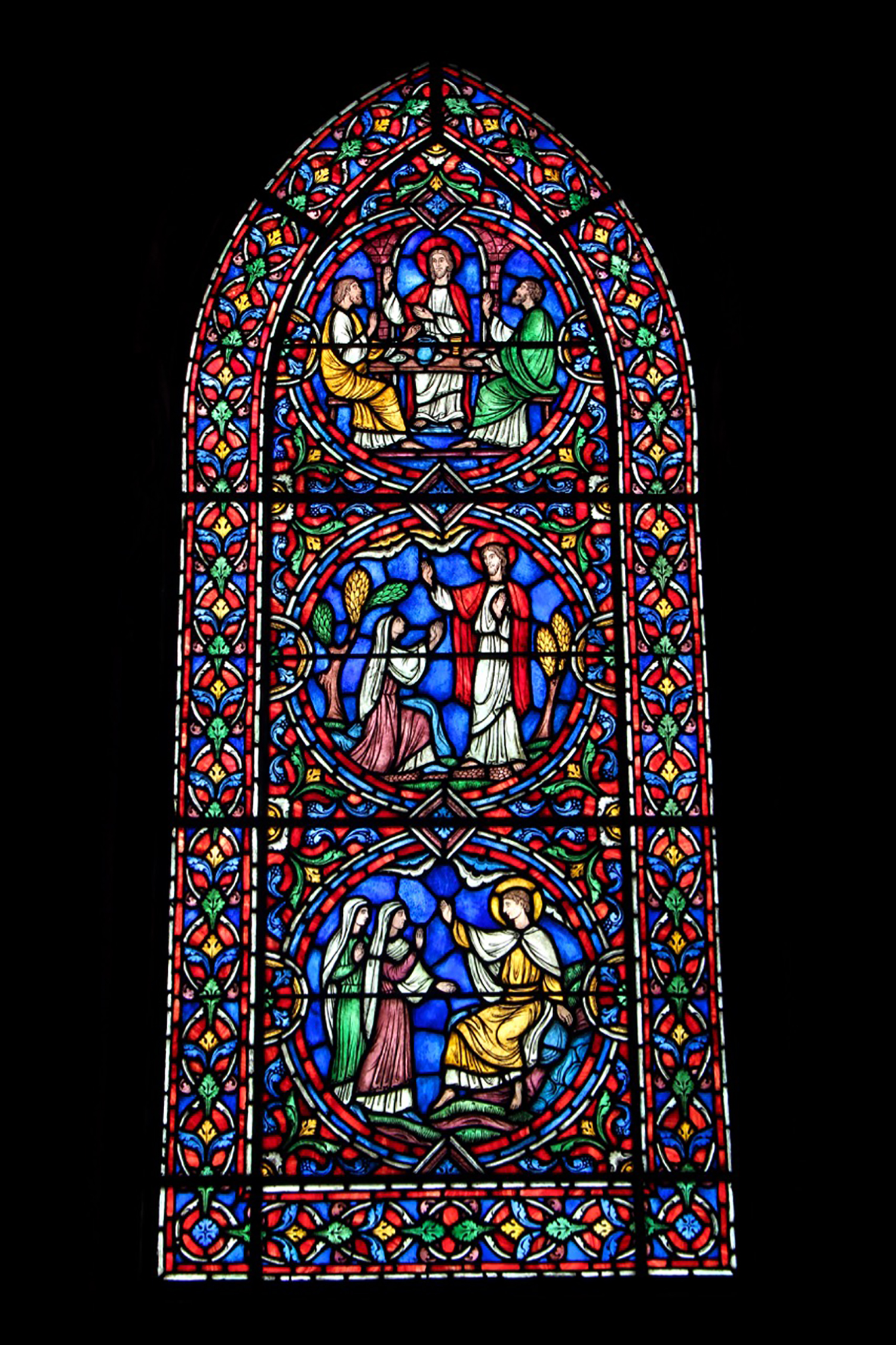 Figure 16: The north window, an original design by Winfred Hyatt, shows scenes from the story of Christ's Resurrection.