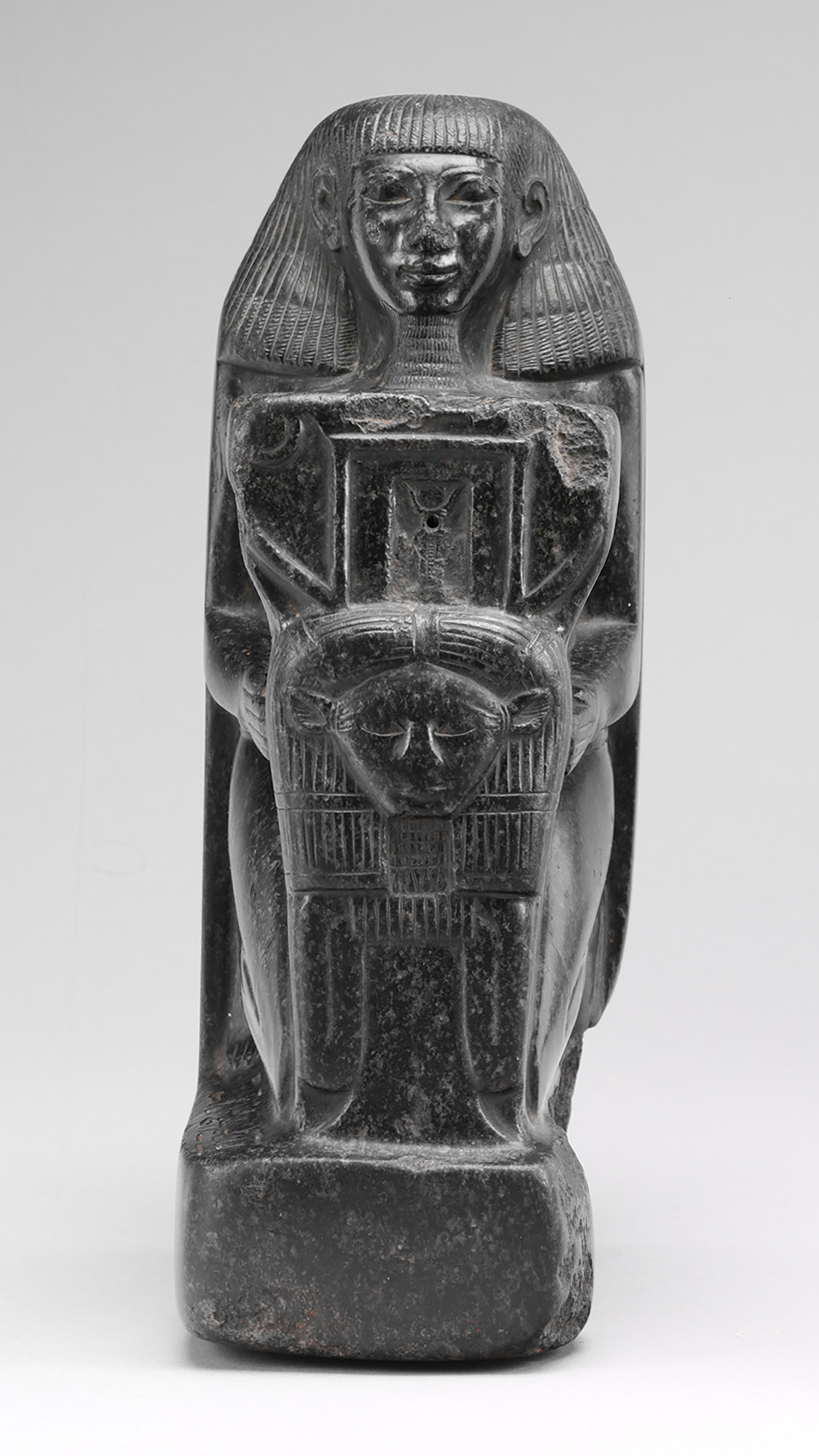 Figure 8: An example of a sisostrous statue. The official, Senmut, holds a sistrum with an image of the goddess Hathor. Photo courtesy of the Metropolitan Museum of Art [48.149.7, Bequest of George D. Pratt, 1935].