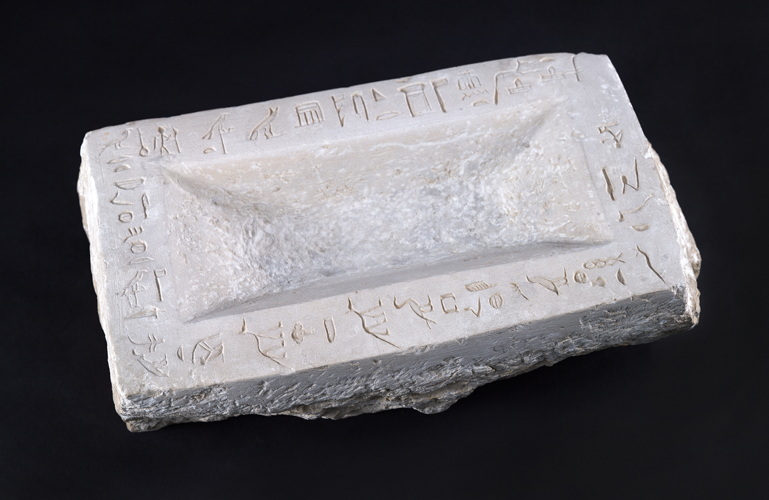 Figure 11: Offering basins were common tomb equipment and were used for liquid offerings. This is an example from an Old Kingdom tomb at Giza. Its rim is decorated with an offering prayer. Photo courtesy of the University of Pennsylvania Museum of Archaeology and Anthropology [UPMAA E13524].